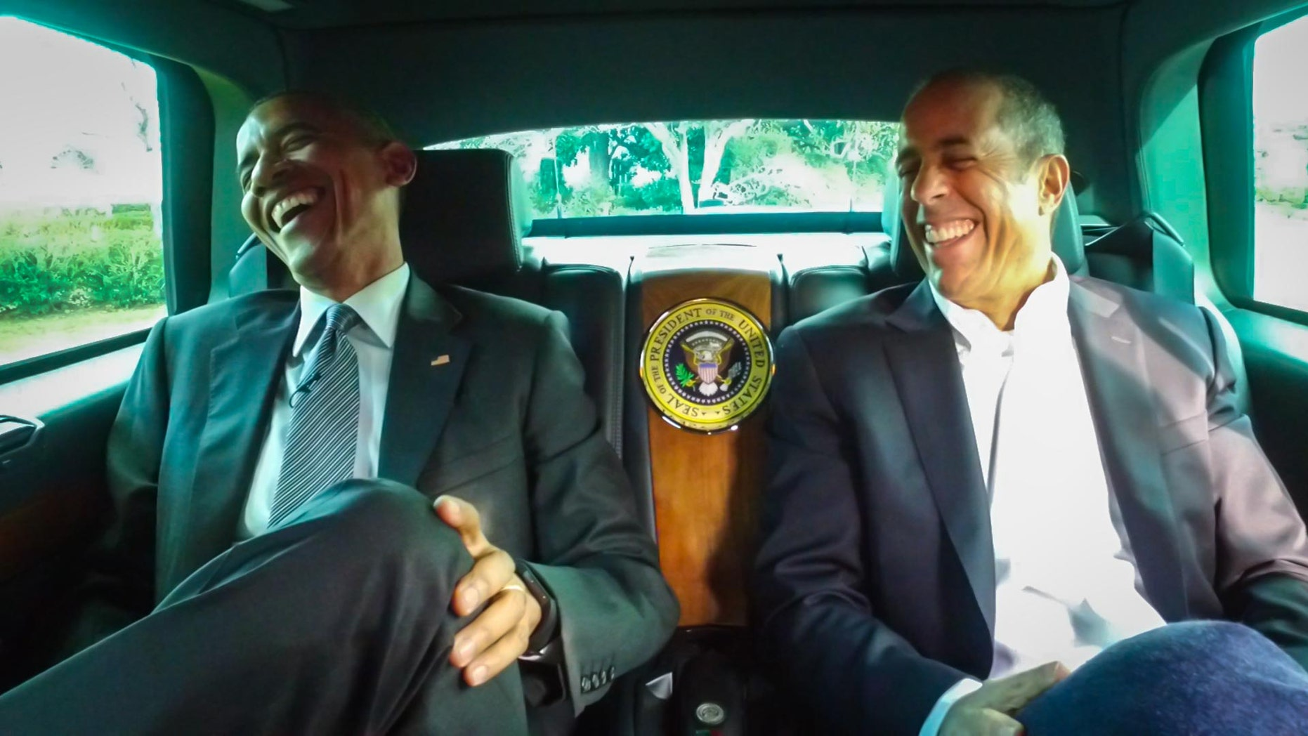 This framegrab image provided by Crackle and comediansincarsgettingcoffee.com, shows President Barack Obama with Jerry Seinfeld in a scene from  a Comedians in Cars Getting Coffee. The president and Seinfeld compare cars and trade one-liners in a 19-minute episode of Comedians In Cars Getting Coffee. The episode began airing Wednesday night. (Crackle and comediansincarsgettingcoffee.com via AP)