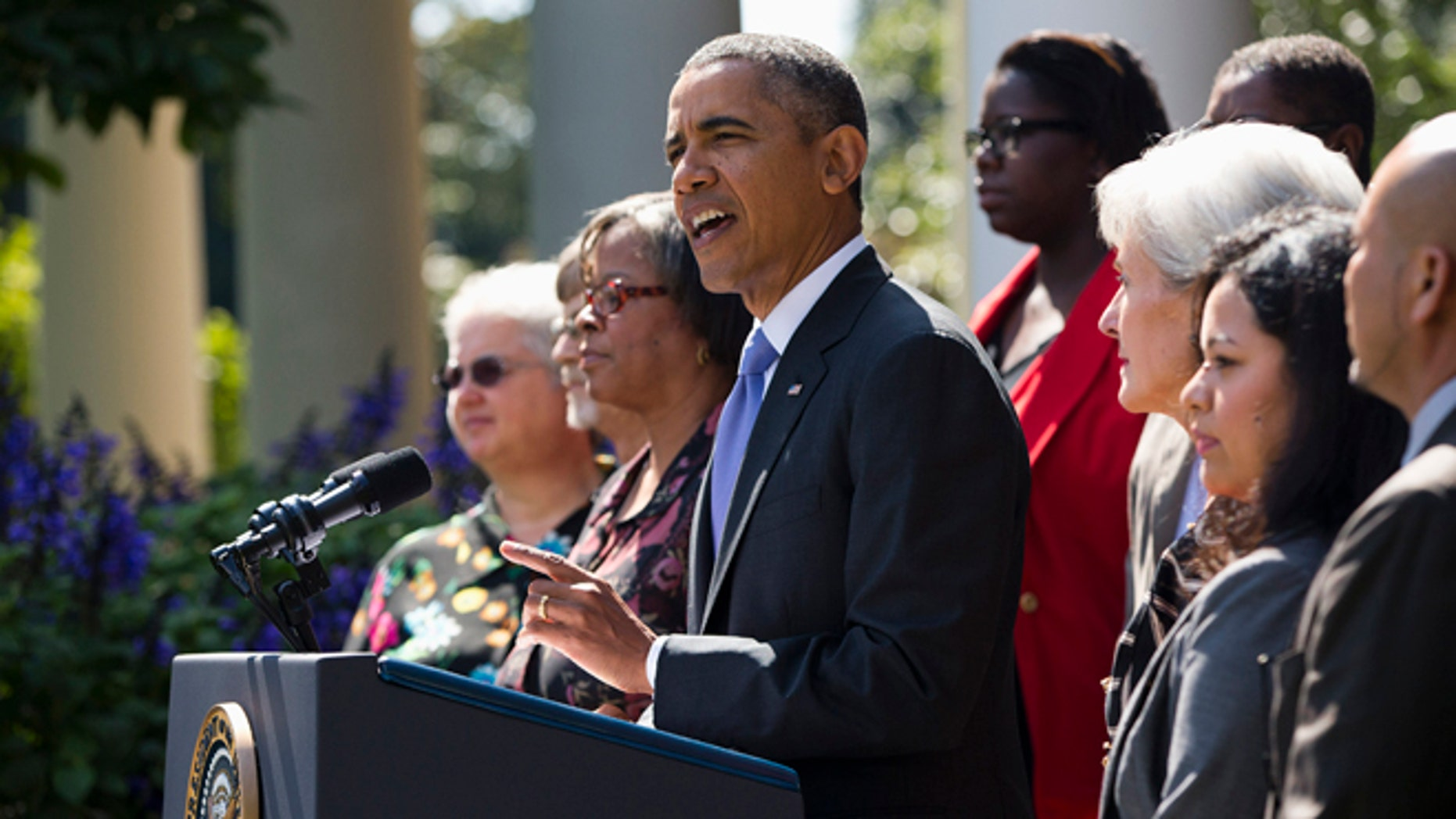 President Barack Obama gestures while speaking  in the Rose Garden of the White House in Washington, Tuesday, Oct. 1, 2013, to talk about the government shutdown. Congress plunged the nation into a partial government shutdown Tuesday as a protracted dispute over Obama's signature health care law reached a boiling point, forcing some 800,000 federal workers off the job.  (AP Photo/ Evan Vucci)