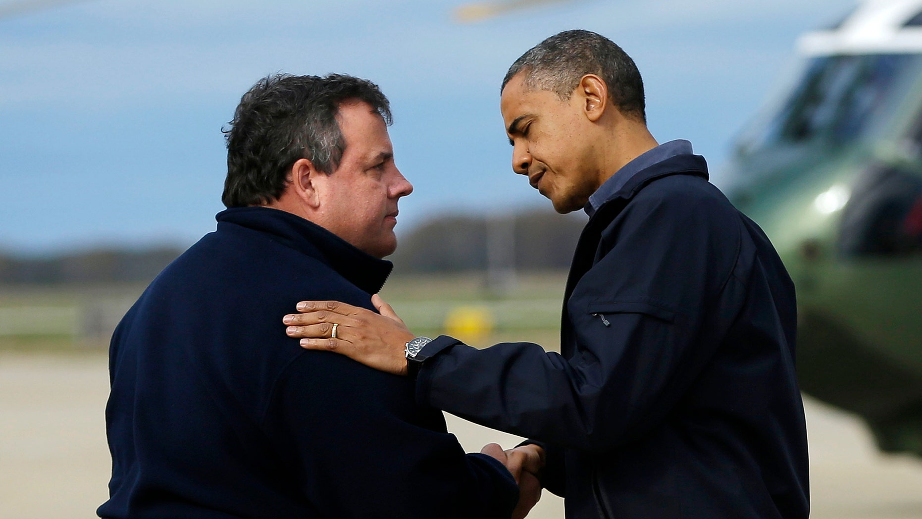 Oct. 31, 2012: President Barack Obama is greeted by New Jersey Gov. Chris Christie upon his arrival at Atlantic City International Airport, in Atlantic City, NJ.