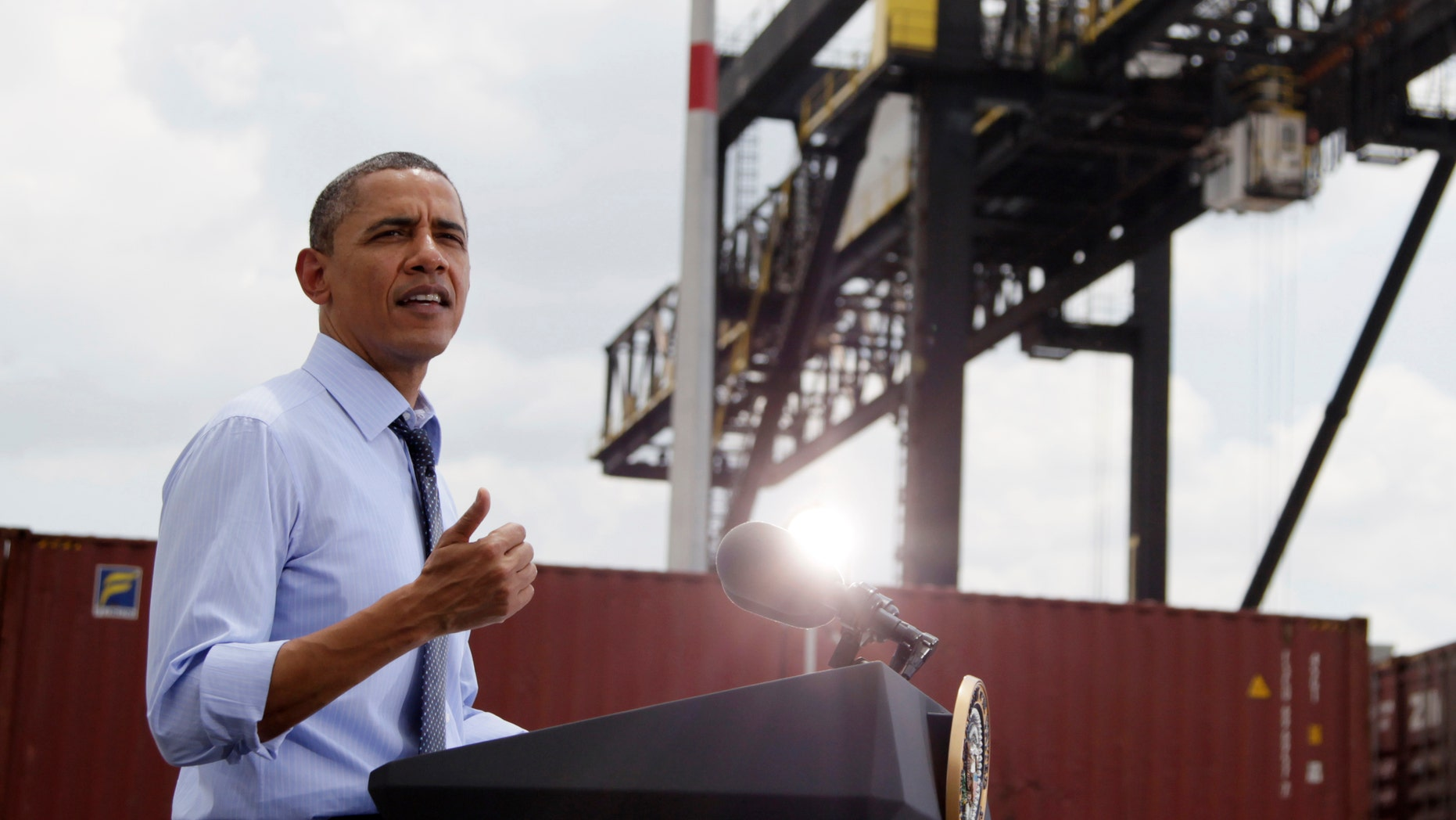 President Barack Obama speaks at the Port of Tampa in Tampa, Fla., ,Friday, April 13, 2012, about trade with Latin America before heading to Colombia for the Summit of the Americas. (AP Photo/Carolyn Kaster)