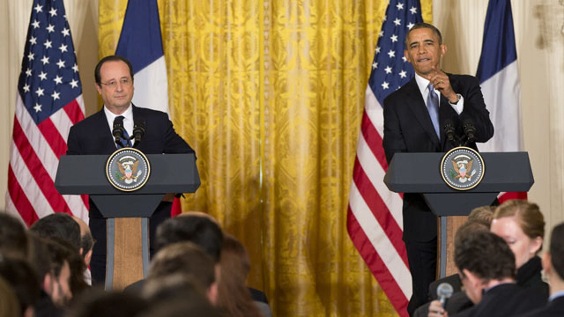 February 11, 2014: President Barack Obama calls on a reporter during a joint news conference with French President François Hollande, as part of an official state visit in the East Room of the White House in Washington. (AP)