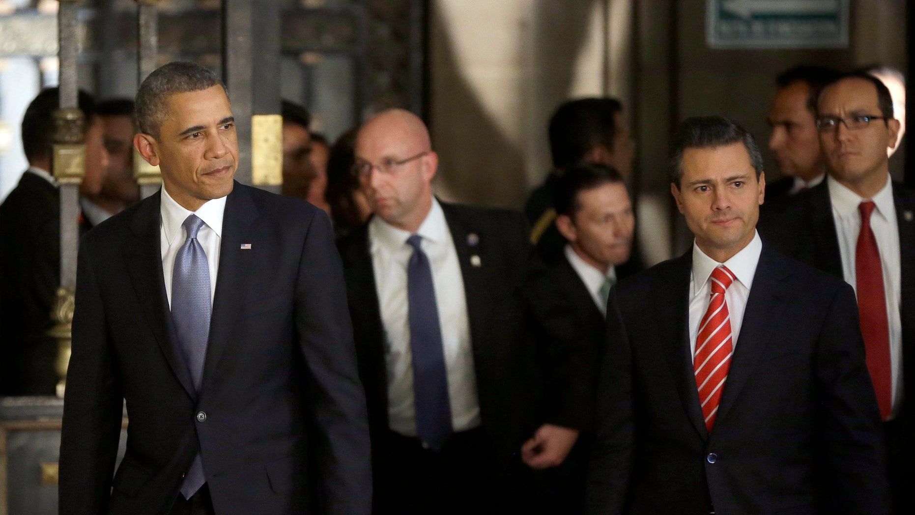 May 2, 2013: President Barack Obama, left, and Mexicos President Enrique Pena Nieto, right, arrive for a news conference at the Palacio Nacional in Mexico City.