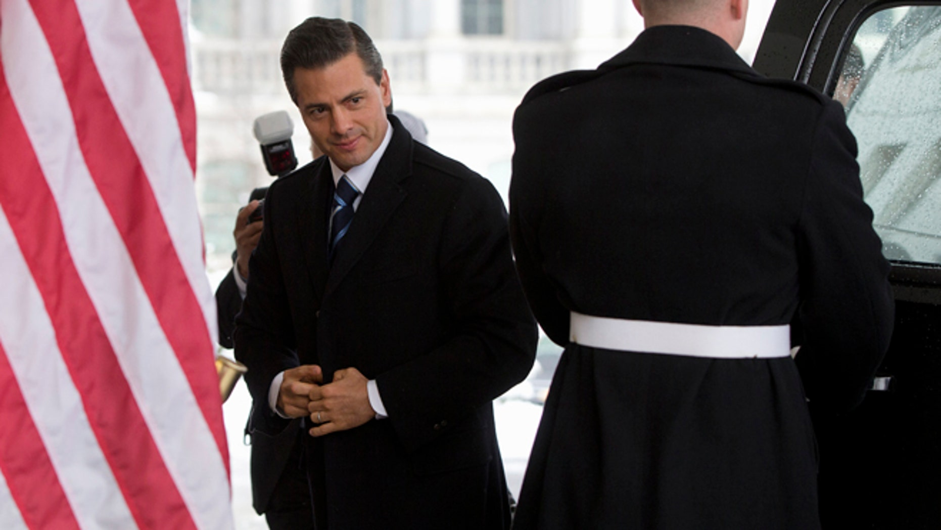 In this Tuesday, Jan. 6, 2015 photo Mexico's President Enrique Pena Nieto arrives at the White House in Washington for meetings with President Barack Obama.