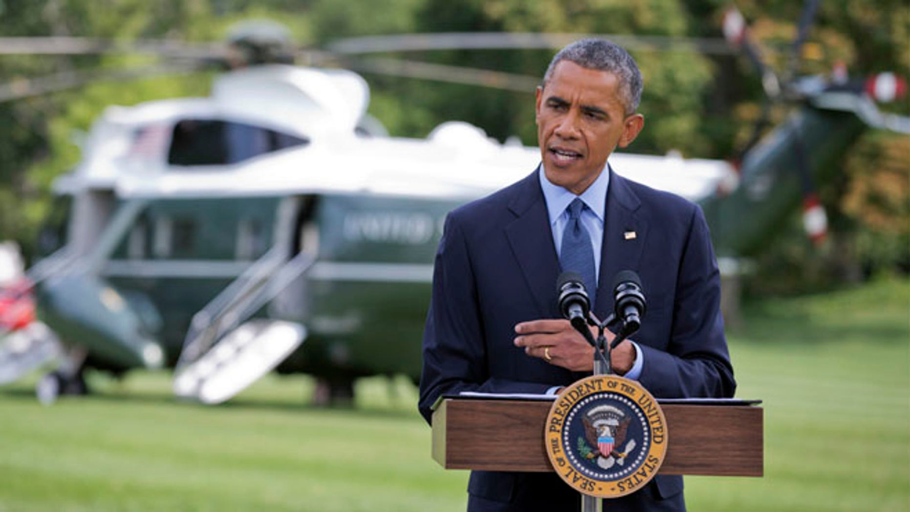 President Barack Obama speaks on the South Lawn of the White House in Washington, Tuesday, July 29, 2014.