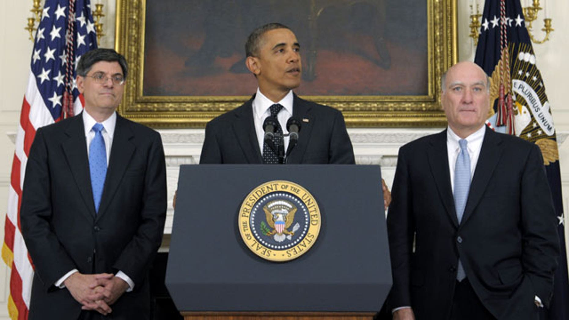 January 9, 2012: President Barack Obama, flanked by outgoing White House Chief of Staff William Daley, right, and his replacement, current Budget Director Jack Lew, makes, the changes announcement in the State Dining Room at the White House in Washington.