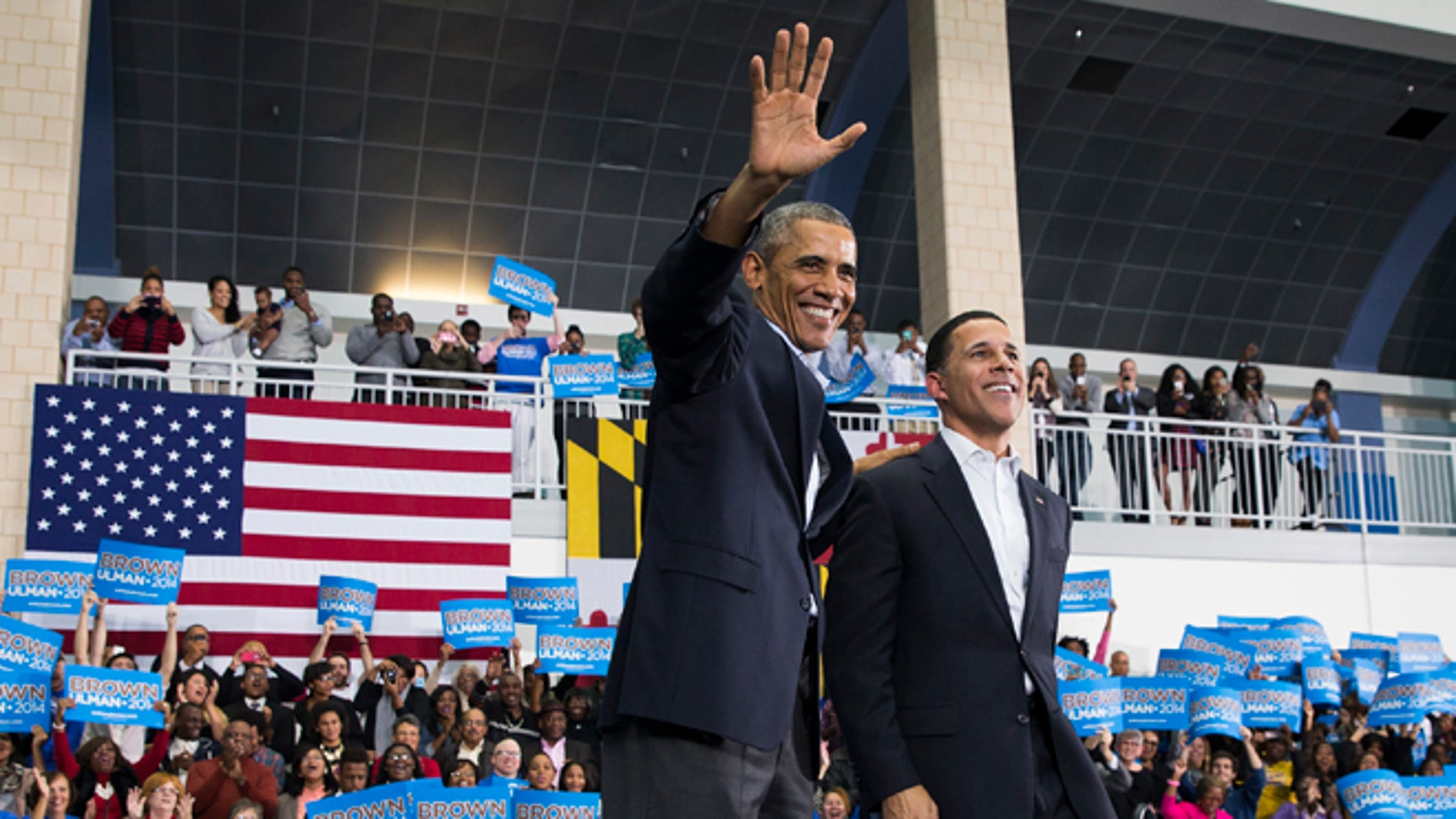 In this Sunday, Oct. 19, 2014 photo, President Barack Obama, left, stands with Maryland gubernatorial candidate Anthony Brown during a campaign rally at Wise High School in Upper Marlboro, Md.