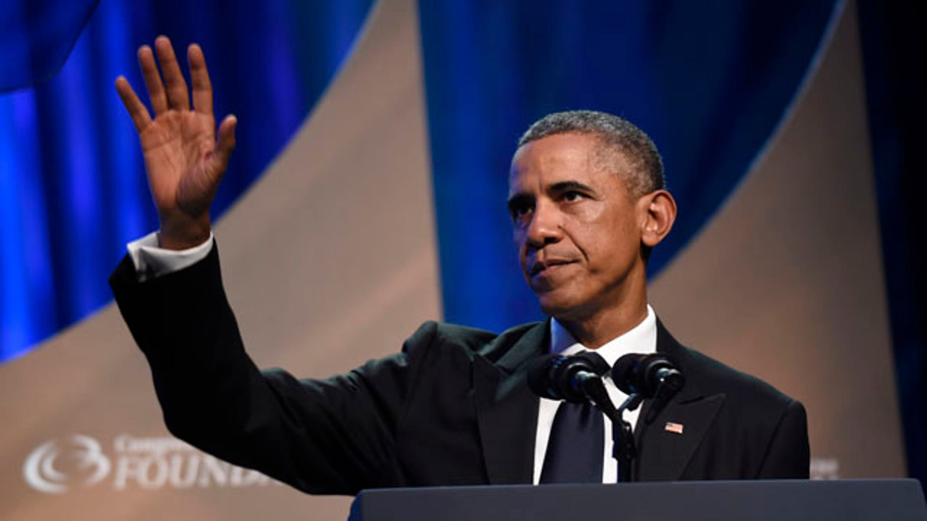 September 27, 2014: President Barack Obama waves to the crowd after speaking at the Congressional Black Caucus Foundations 44th Annual Legislative Conference Phoenix Awards Dinner in Washington. (AP Photo/Susan Walsh)