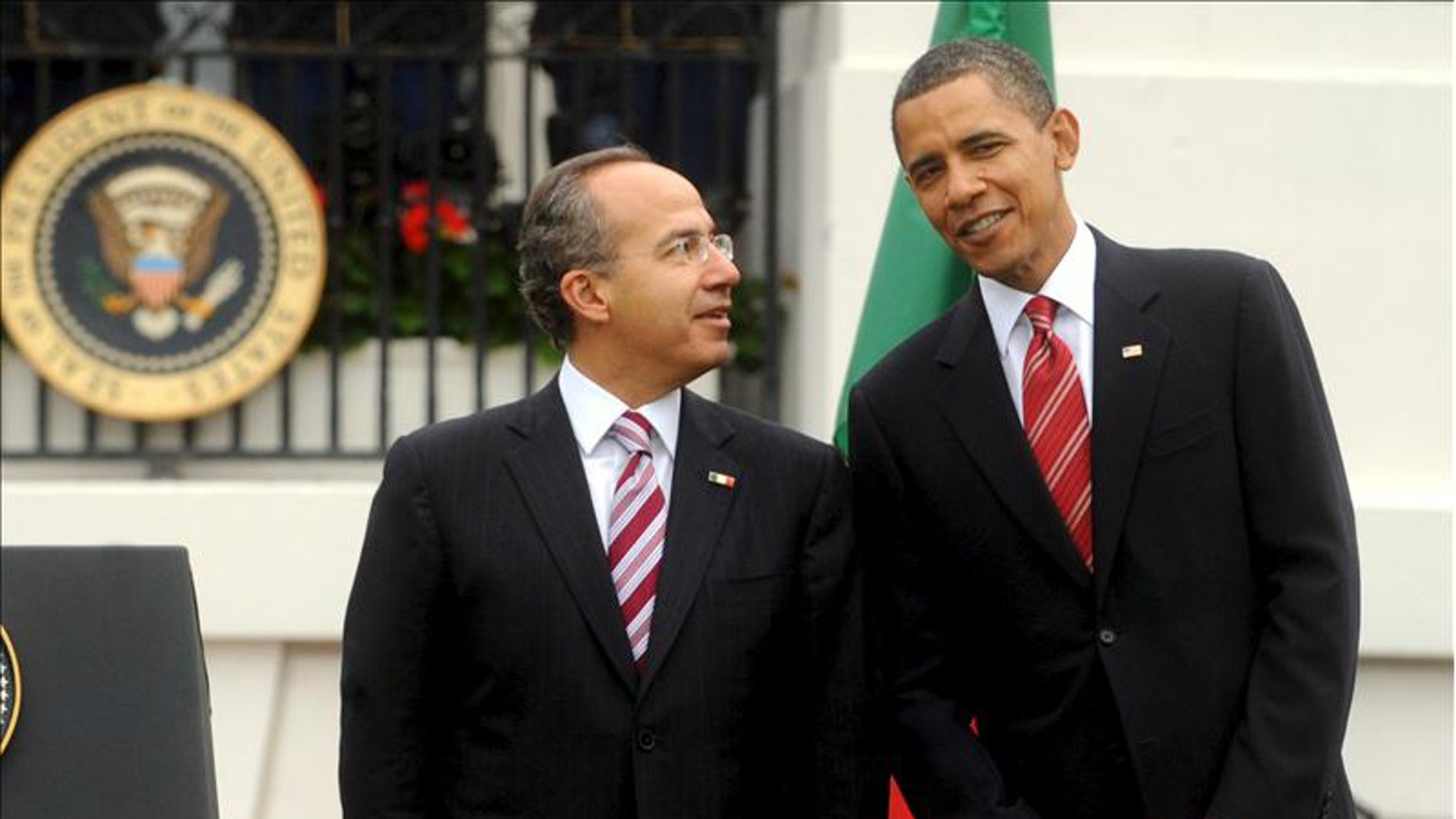 Thursday: President Obama poses for photos with Mexican President Felipe Calderon.