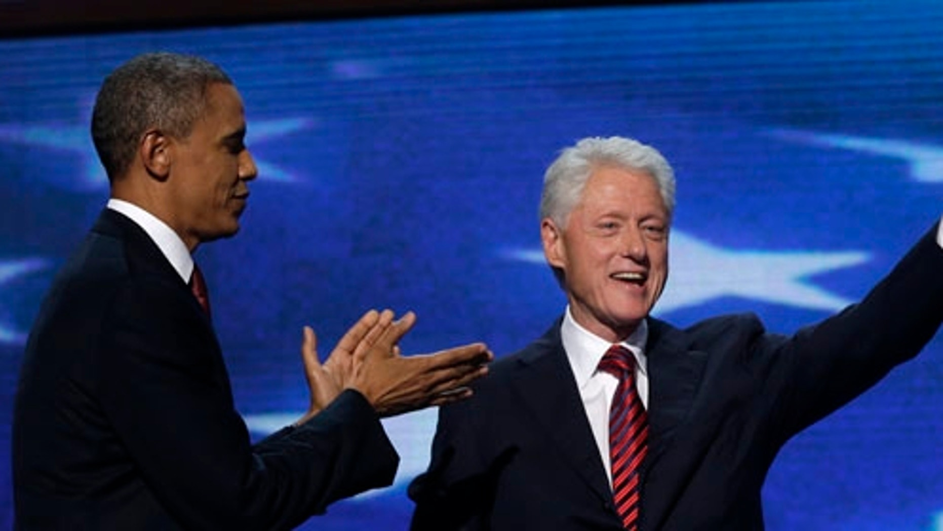 Former President Bill Clinton waves after addressing the Democratic National Convention as President Barack Obama greets in Charlotte, N.C., on Wednesday, Sept. 5, 2012. (AP Photo/Charles Dharapak)