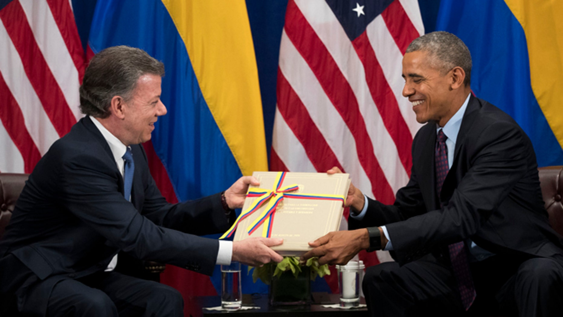 NEW YORK, NEW YORK - SEPTEMBER 21: (L to R) President of Colombia Juan Manuel Santos gives U.S. President Barack Obama a copy of the Colombian peace agreement during bilateral meeting at the Lotte New York Palace Hotel, September 21, 2016 in New York City. In Tuesday's speech to the United Nations General Assembly, Obama stated that 'helping Colombia end Latin America's longest war' was among his major accomplishments as president. Last month, the Colombian government reached a peace agreement with the Revolutionary Armed Forces of Colombia (FARC). (Photo by Drew Angerer/Getty Images)