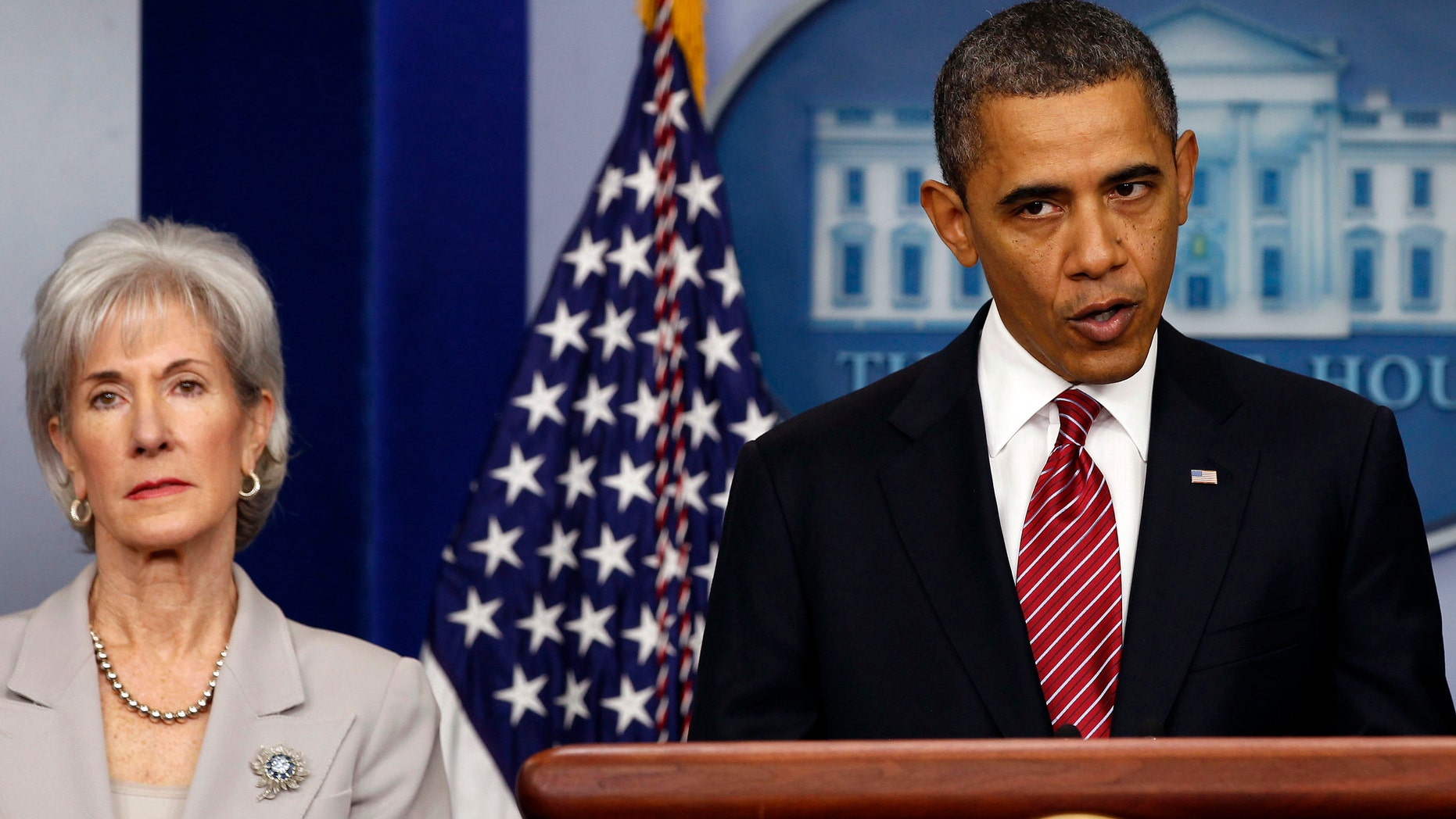 U.S. President Barack Obama makes a statement next to Secretary of HHS Kathleen Sebelius about contraceptive care funding in the press room of the White House in Washington.