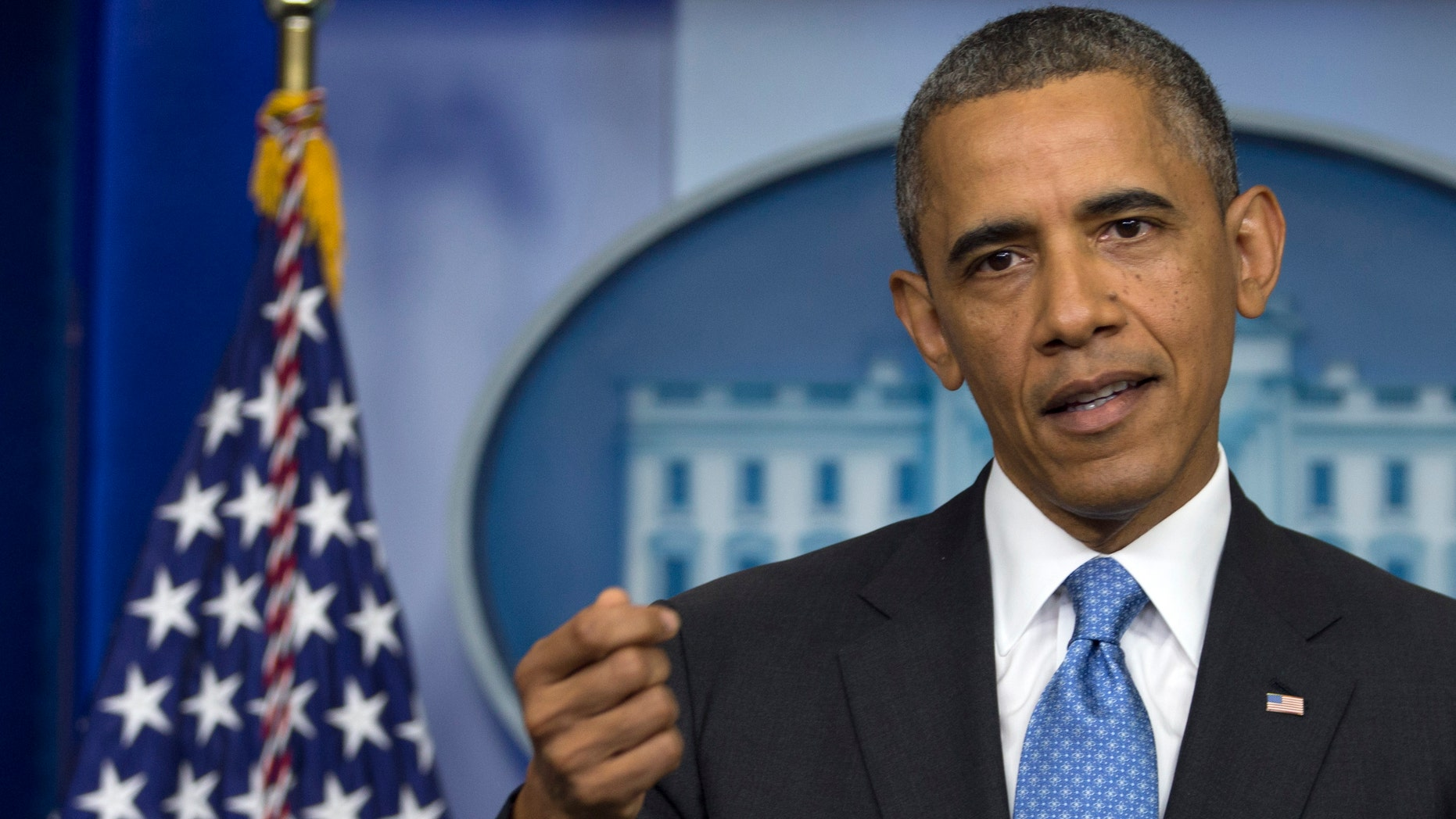 President Barack Obama gestures as he speaks during his daily news briefing at the White House, Friday, July 19, 2013, in Washington, about the fatal shooting of Trayvon Martin by George Zimmerman. (AP Photo/Carolyn Kaster)