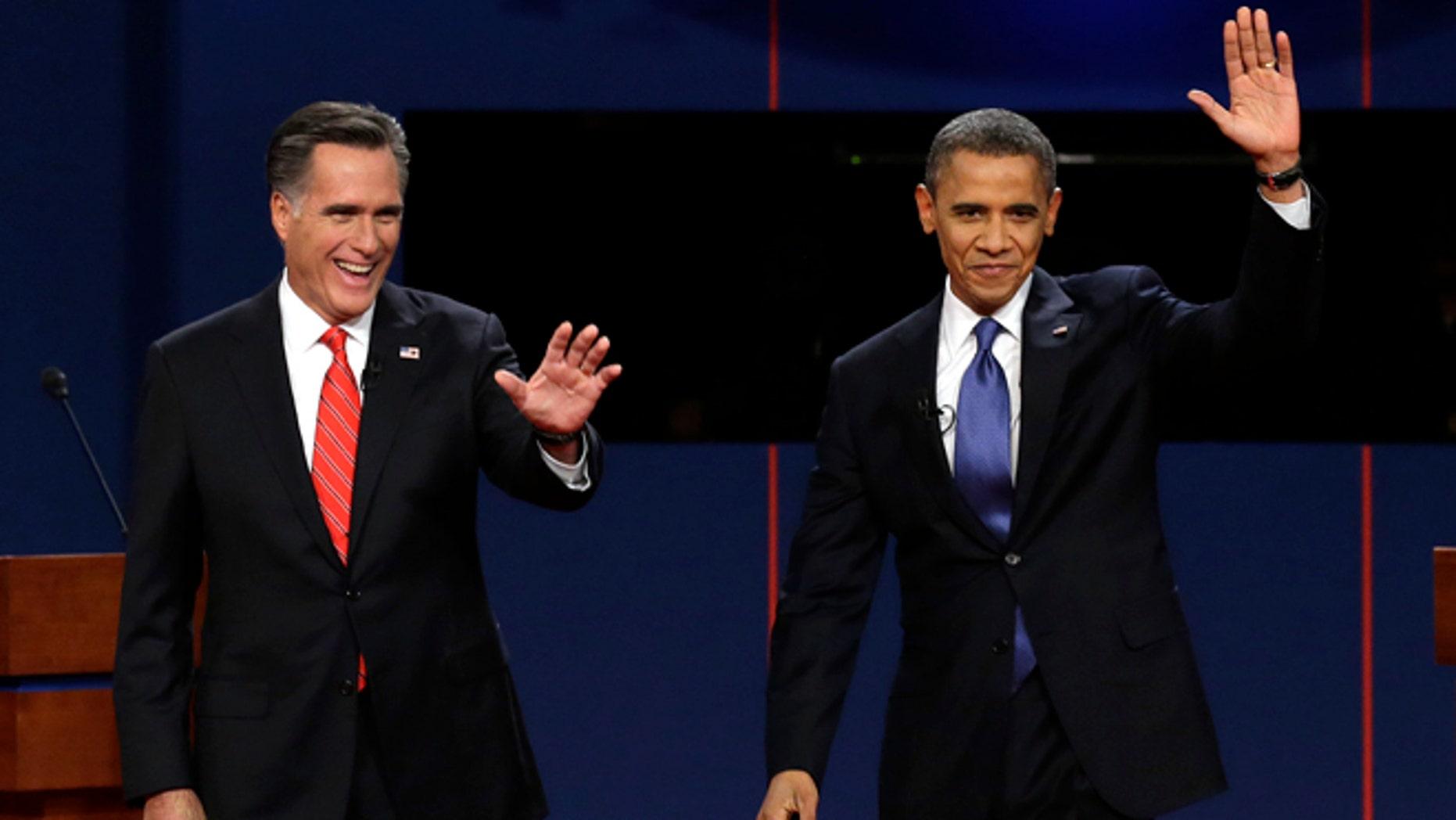 FILE: Oct. 3, 2012: Mitt Romney and President Obama during the first presidential debate at the University of Denver in Denver.