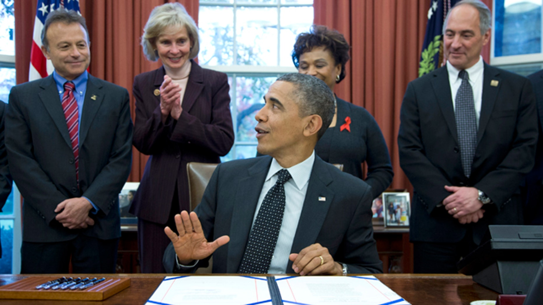 Nov. 21, 2013: President Barack Obama speaks in the Oval Office of the White House in Washington, after signing S. 330: the HIV Organ Policy Equity Act.