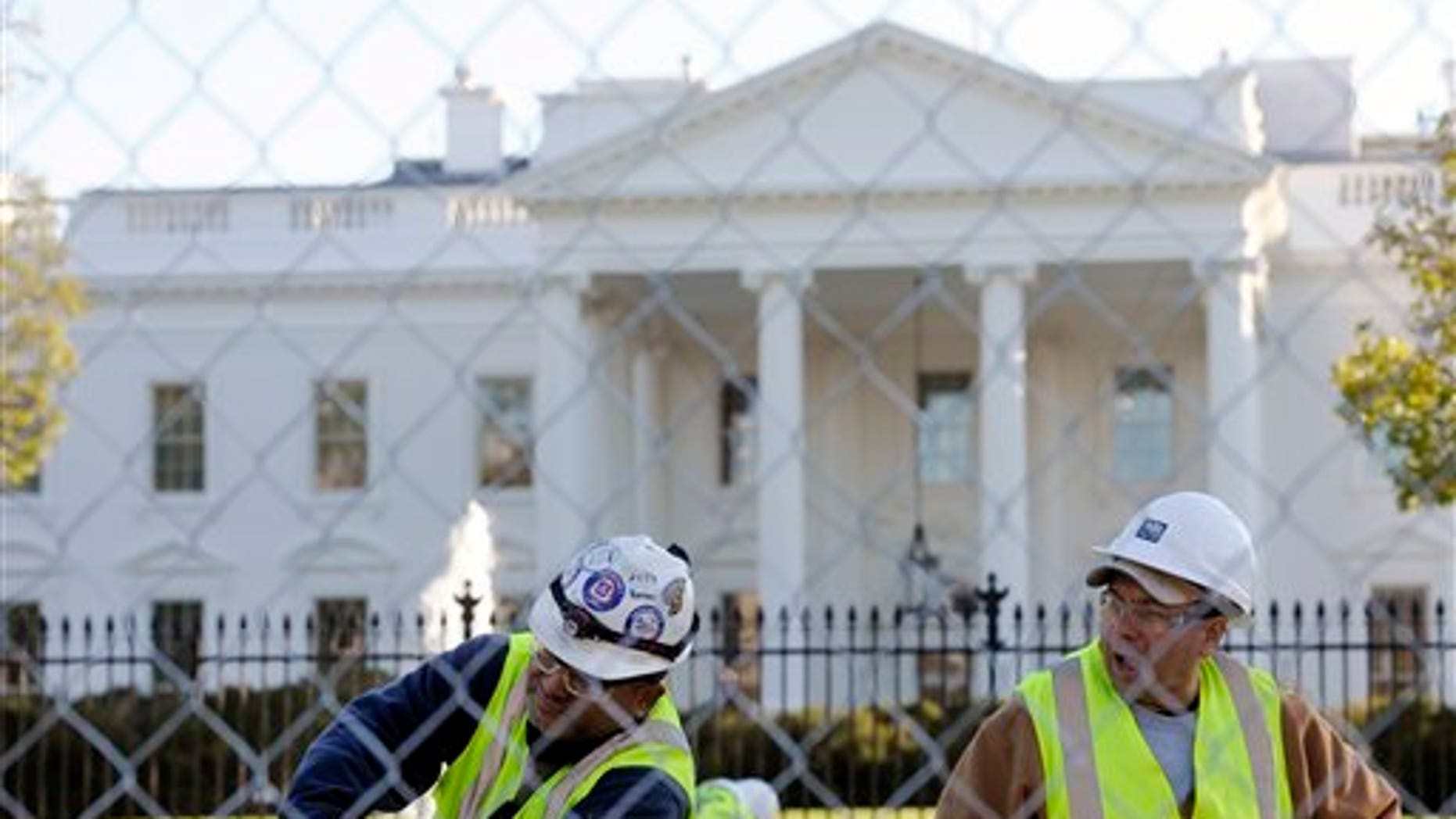 Nov. 8, 2012: Workers secure rebar for concrete footings for the Presidential Inauguration reviewing stand in front of the White House.