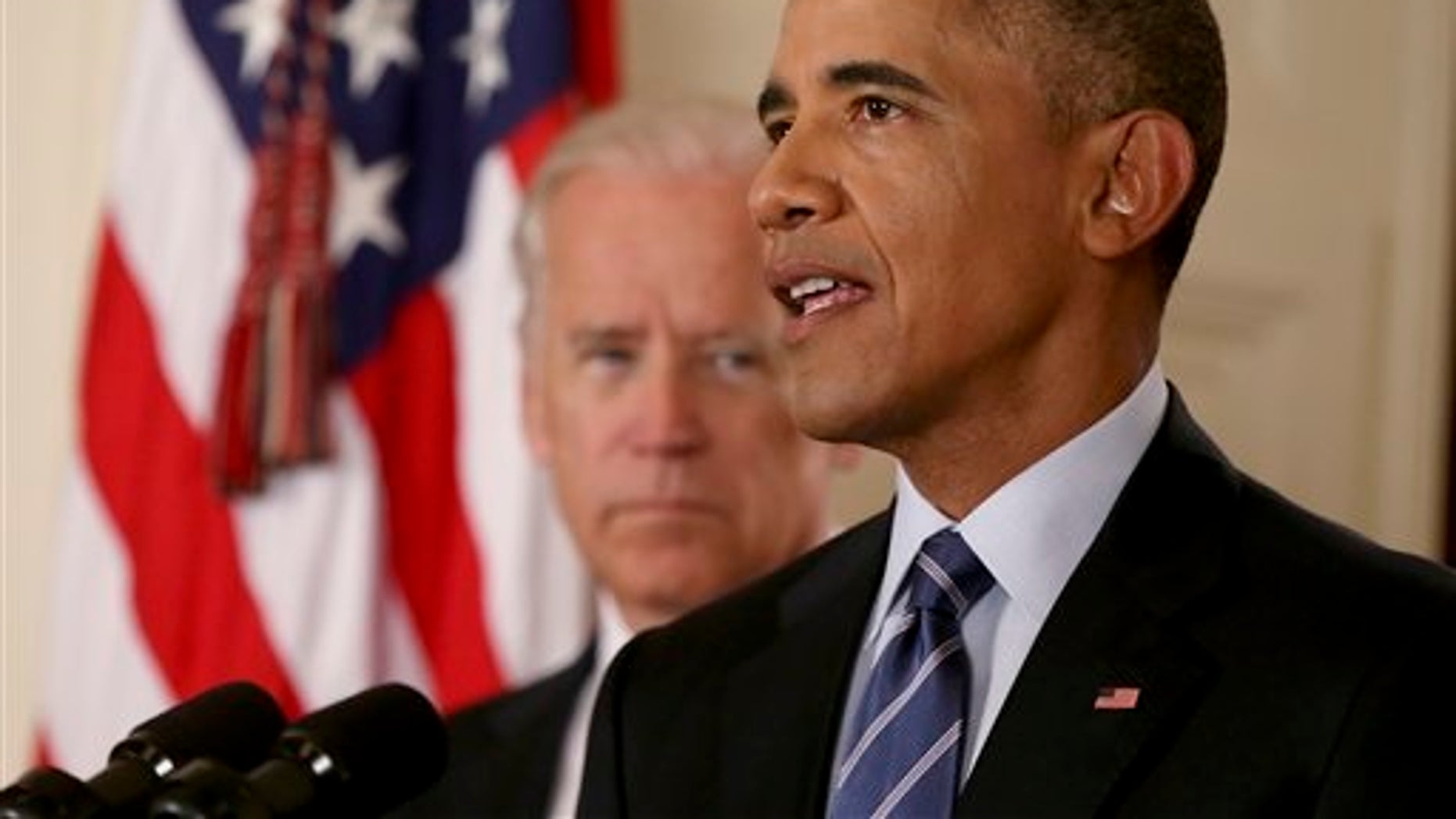 President Barack Obama, standing with Vice President Joe Biden, delivers remarks in the East Room of the White House in Washington, Tuesday, July 14, 2015, after an Iran deal is reached.  Obama says every path to a nuclear weapon will be cut off from Iran under a historic agreement announced in Vienna. (AP Photo/Andrew Harnik, Pool)