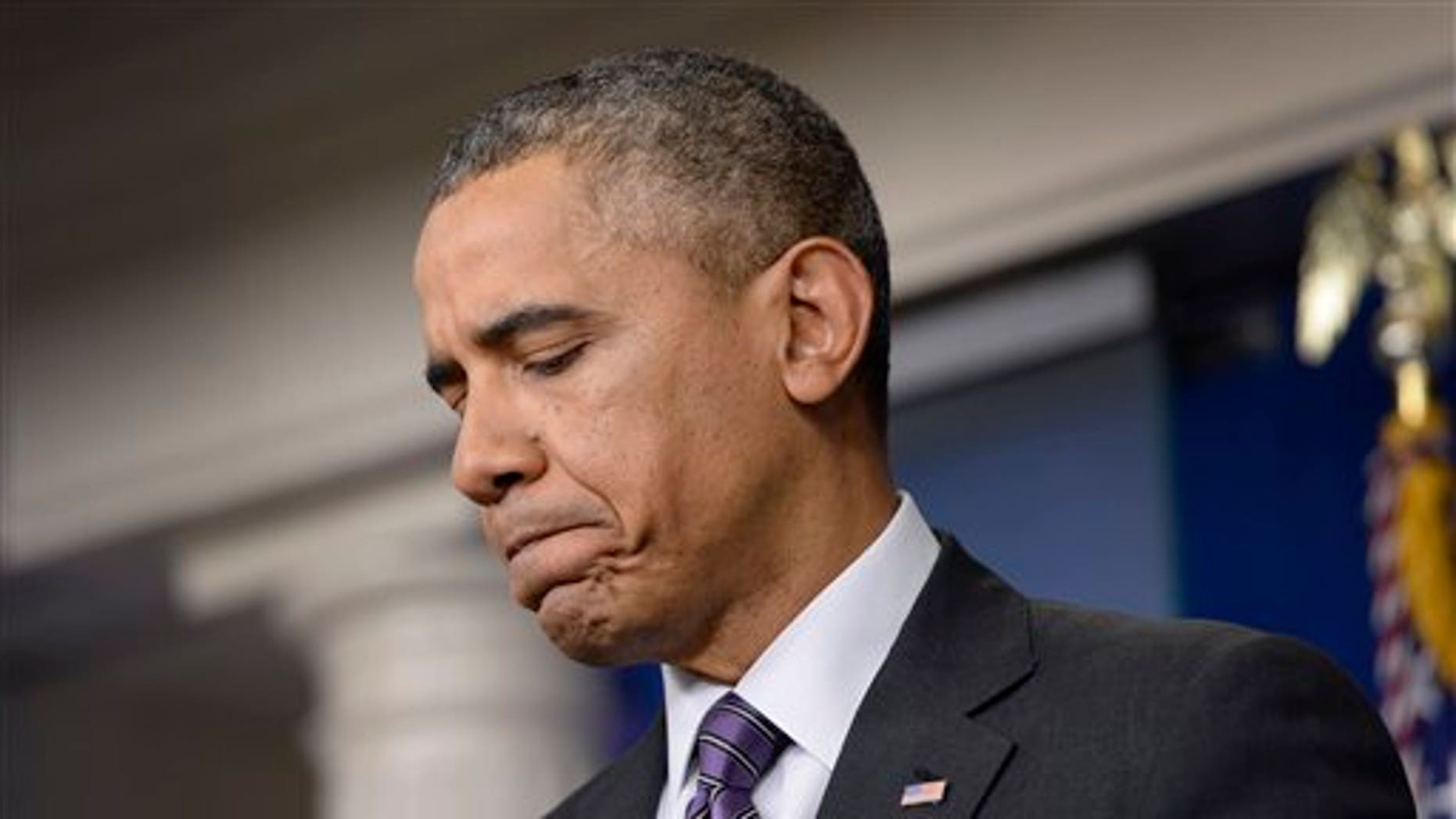 President Barack Obama pauses as he talks about the ferry disaster in South Korea at the start of a news conference in the Brady Press Briefing Room of the White House in Washington, Thursday, April 17, 2014. Obama was asked about the Affordable Care Act, the crisis in Ukraine and other issues. (AP Photo/Susan Walsh)