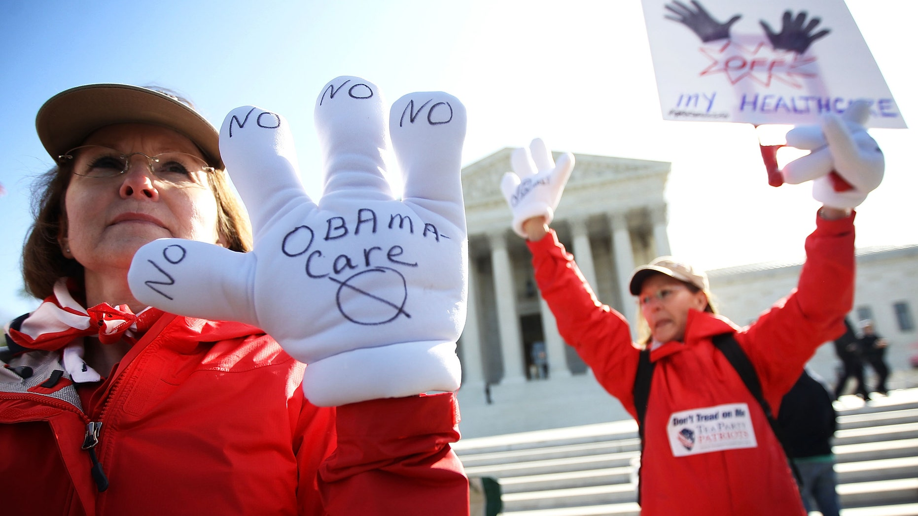 WASHINGTON, DC - MARCH 27: Sisters and Tea Party members of Atlanta, Georgia, Judy Burel (L) and Janis Haddon (R), protest the Obamacare in front of the U.S. Supreme Court March 27, 2012 in Washington, DC. The Supreme Court continued to hear oral arguments on the Patient Protection and Affordable Care Act.  (Photo by Alex Wong/Getty Images)
