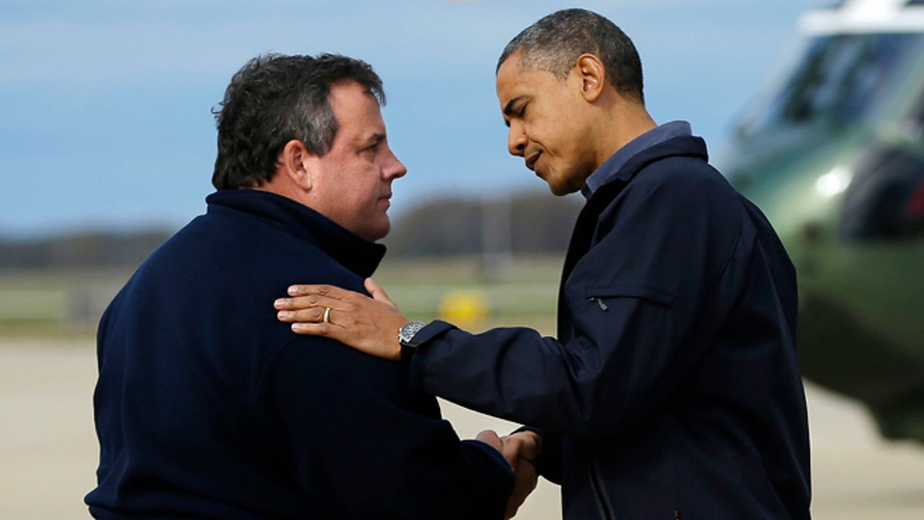 Oct. 31, 2012: President Barack Obama is greeted by New Jersey Gov. Chris Christie upon his arrival at Atlantic City International Airport in Atlantic City, NJ.