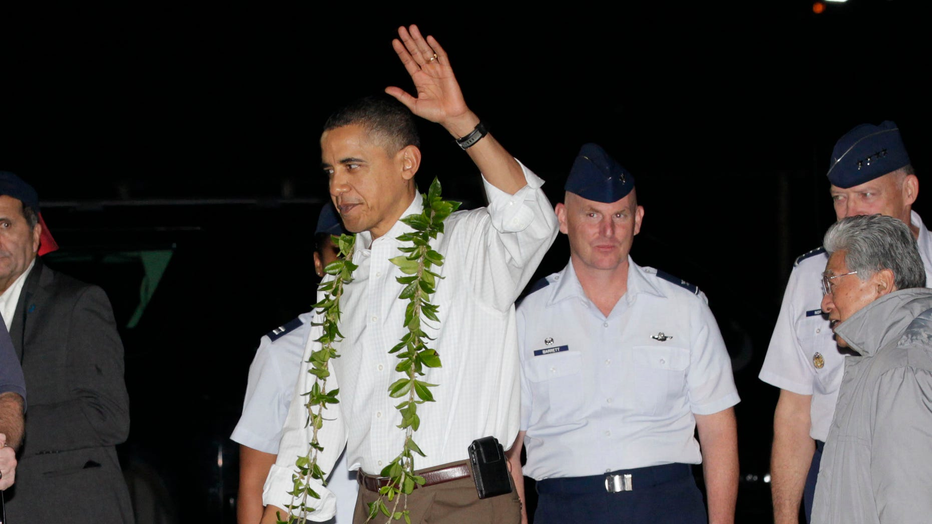 Dec. 22: Obama waves after deplaning from Force One as he arrives at Hickam Air Force Base in Honolulu to start his vacation.