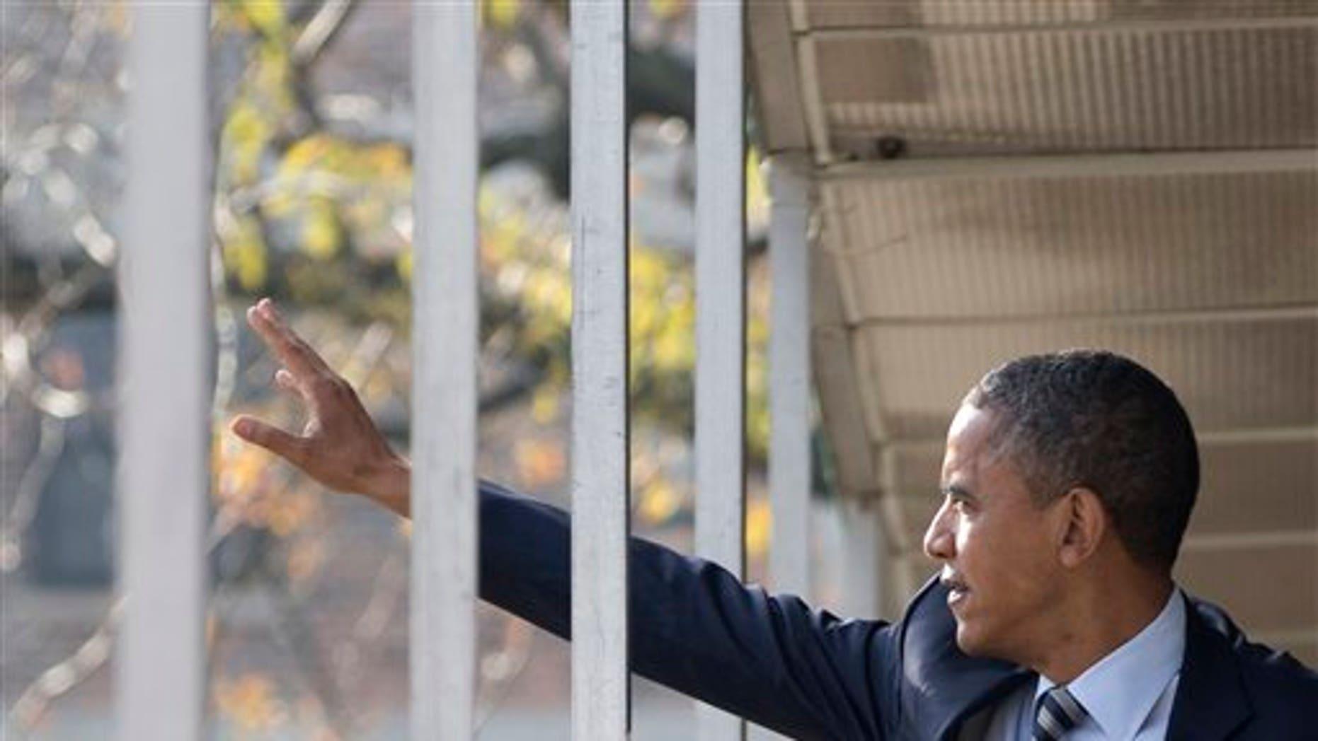 Nov. 6, 2012: Obama walks through a hallway on Election Day.