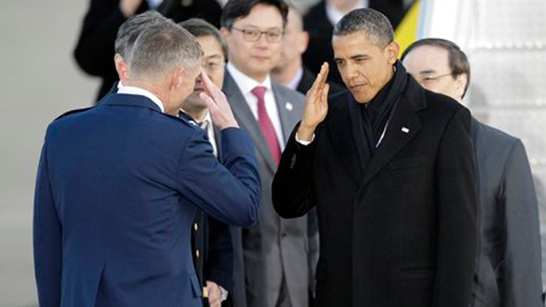 Mar. 25, 2012: President Barack Obama salutes upon arrival at Osan Air Base to attend the Nuclear Security Summit, in Osan, south of Seoul, South Korea.