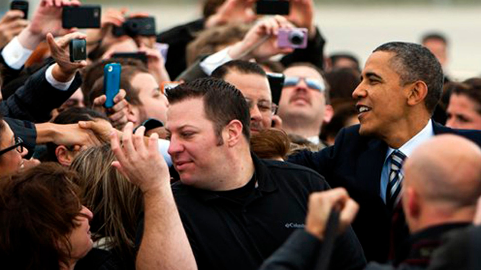 Feb. 15, 2012: President Barack Obama greets supporters as he arrives on Air Force One at Los Angeles International airport.