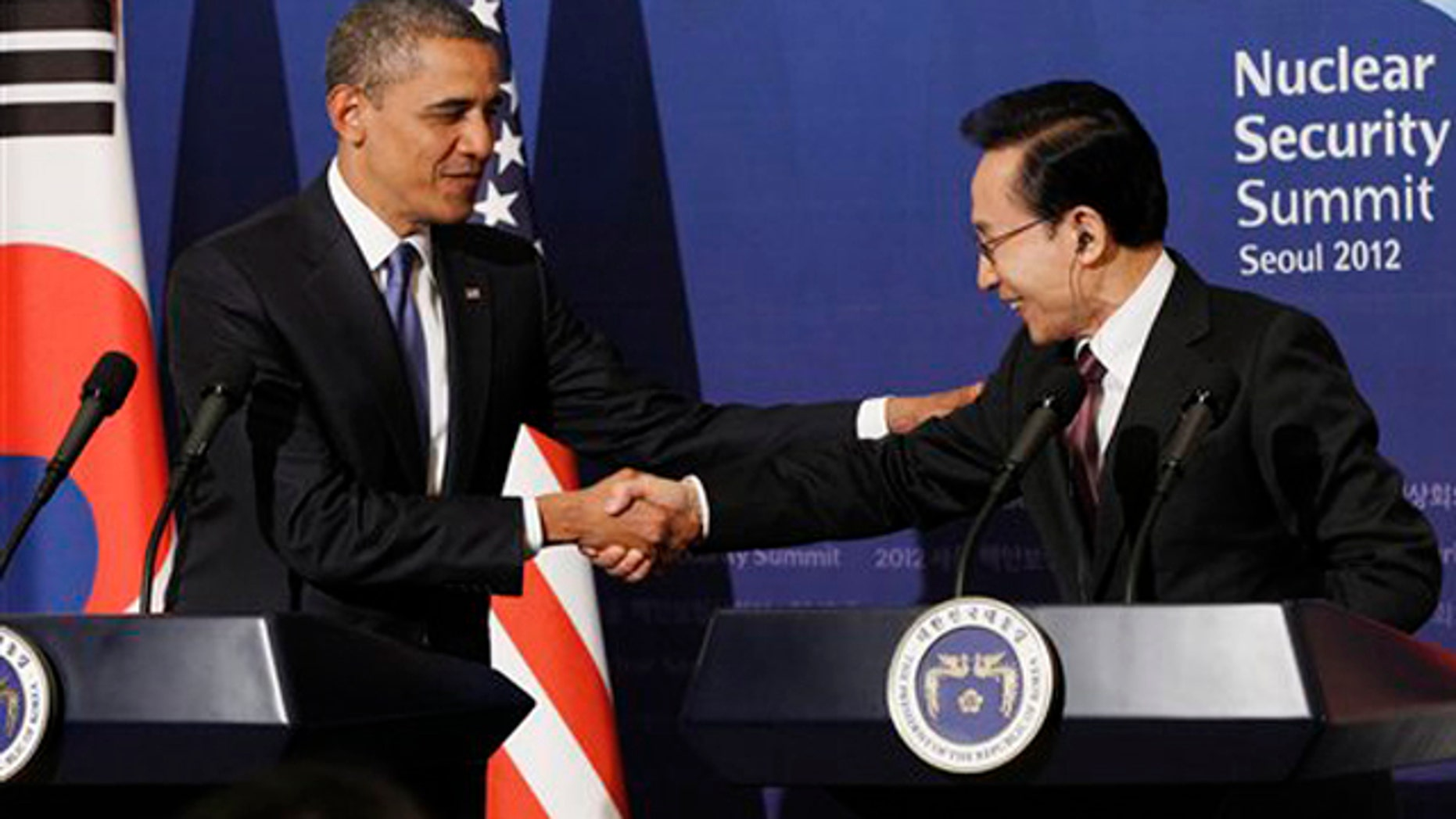 Mar. 25, 2012: U.S. President Barack Obama shakes hands with South Korean President Lee Myung-bak during their joint news conference at the presidential Blue House in Seoul.
