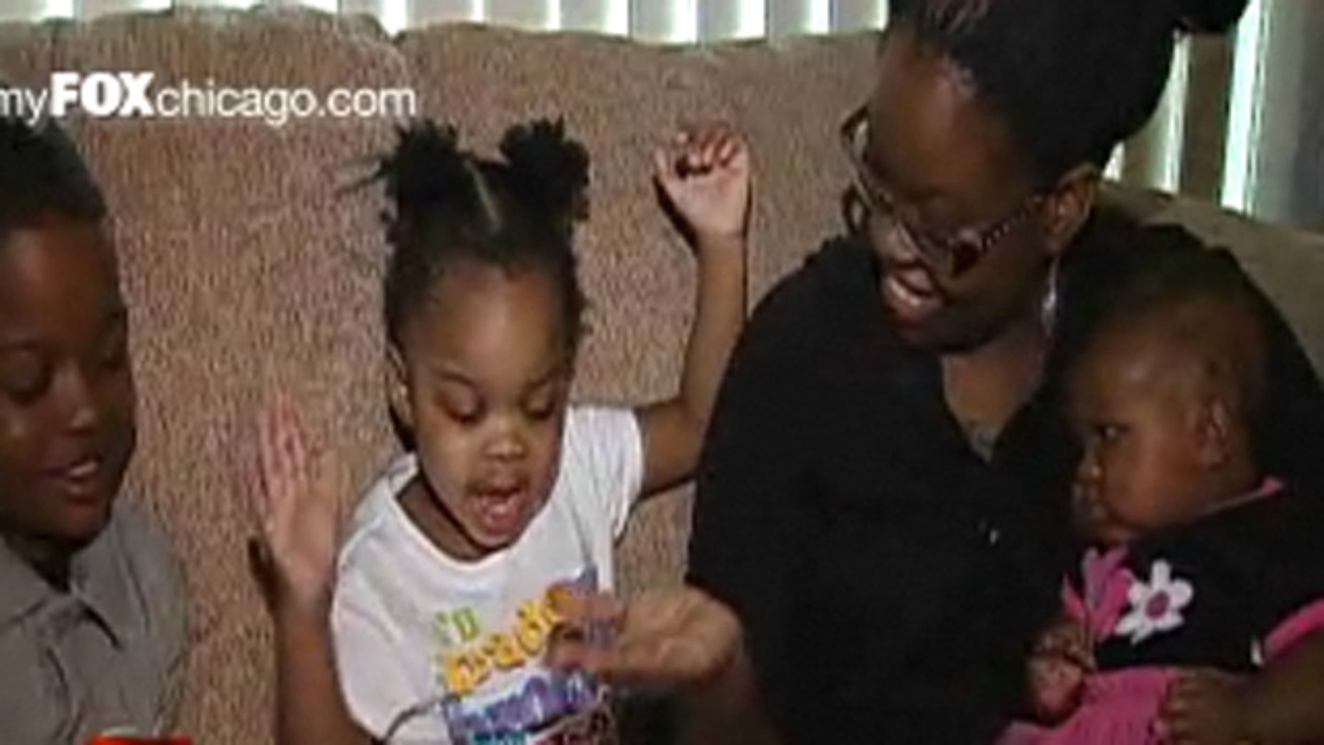 Destiny Mathis, seen here with her children, decided to sell the letter President Obama sent her to help pay bills.