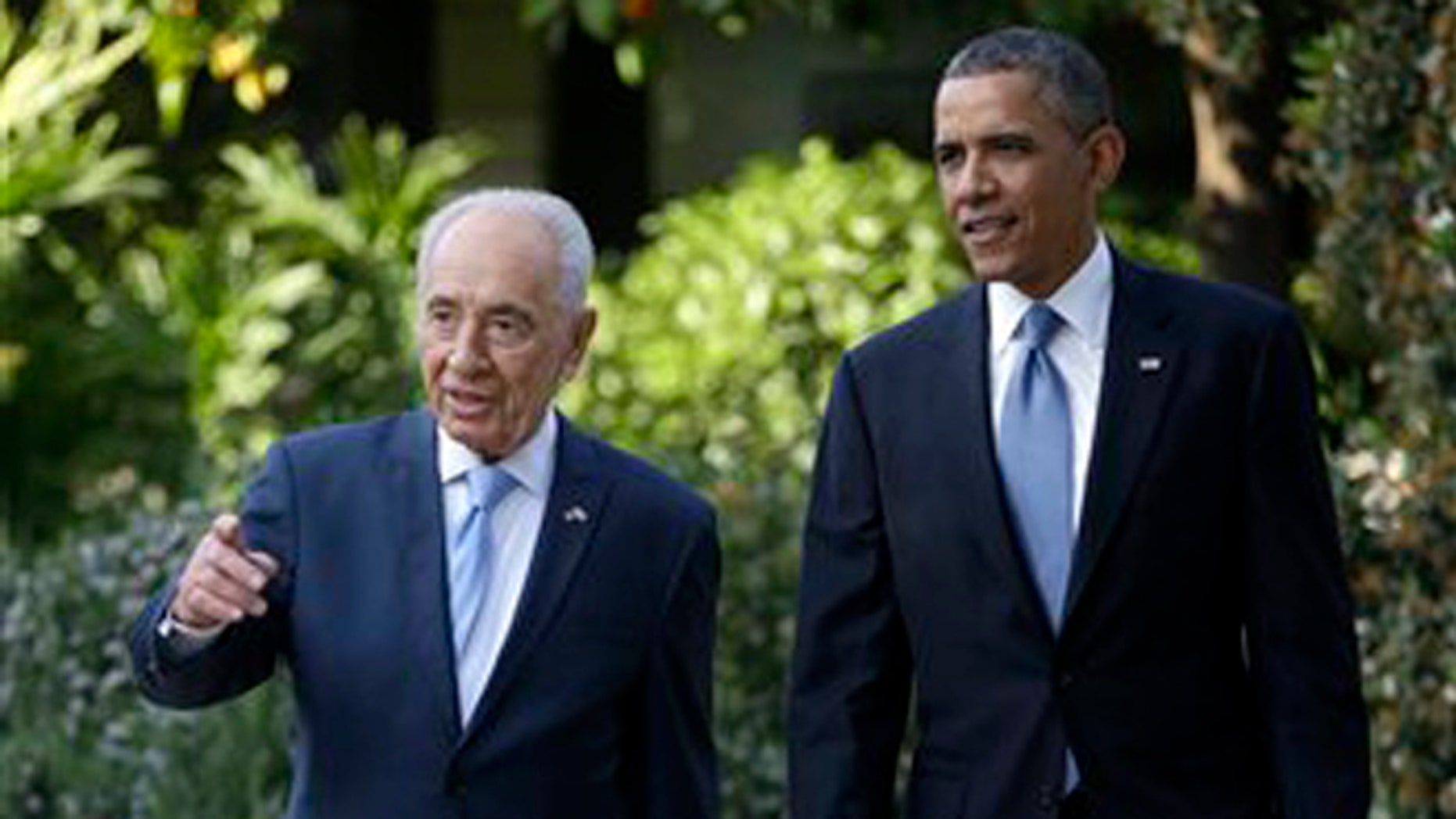 March 20: President Obama tours the garden of the President's Residence with Israeli President Shimon Peres in Jerusalem, Israel.