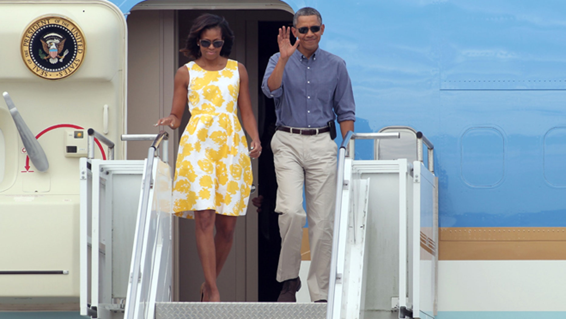 Aug 10, 2013: President Barack Obama and first lady Michelle Obama arrive at the Cape Cod Coast Guard Station in Bourne, Mass.,en route to a family vacation on Martha's Vineyard.