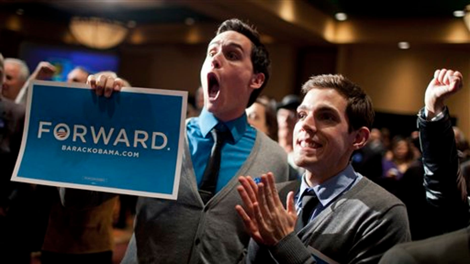 Nov. 6, 2012: New Mexico democrats including Clint Milhollin, left, and his boyfriend Will Toledo, celebrate at the Embassy Suites.
