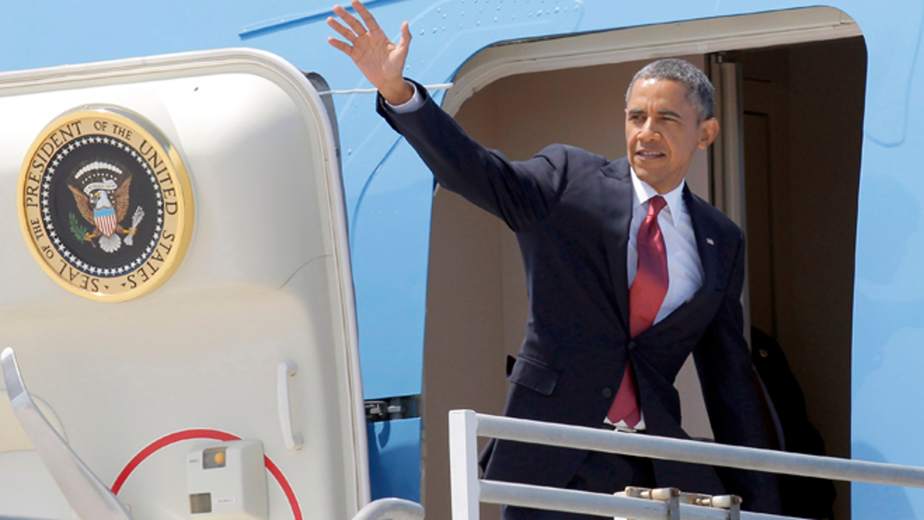 Aug 7, 2013: President Barack Obama waves from the door of Air Force One for his return to Washington, after a two-day swing through Southern California, at Los Angeles International Airport.