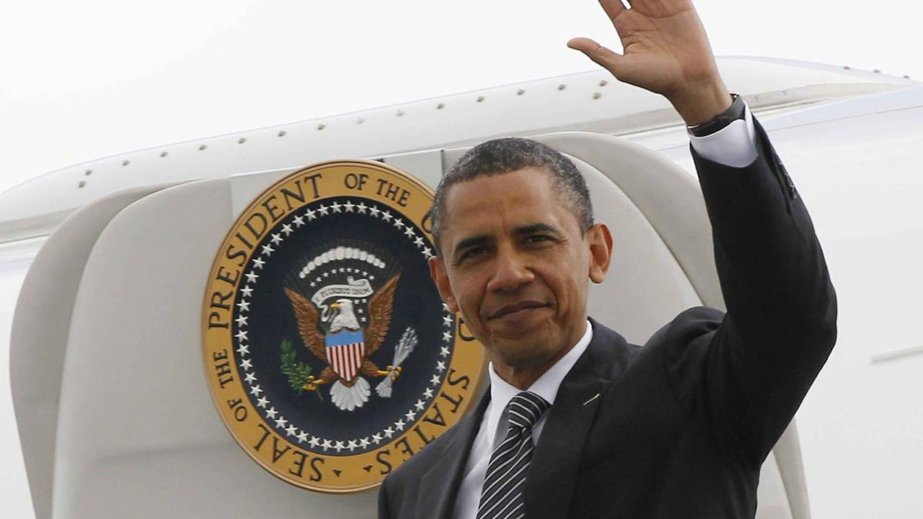 President Barack Obama steps off Air Force One in France. (AP Photo/Charles Dharapak)