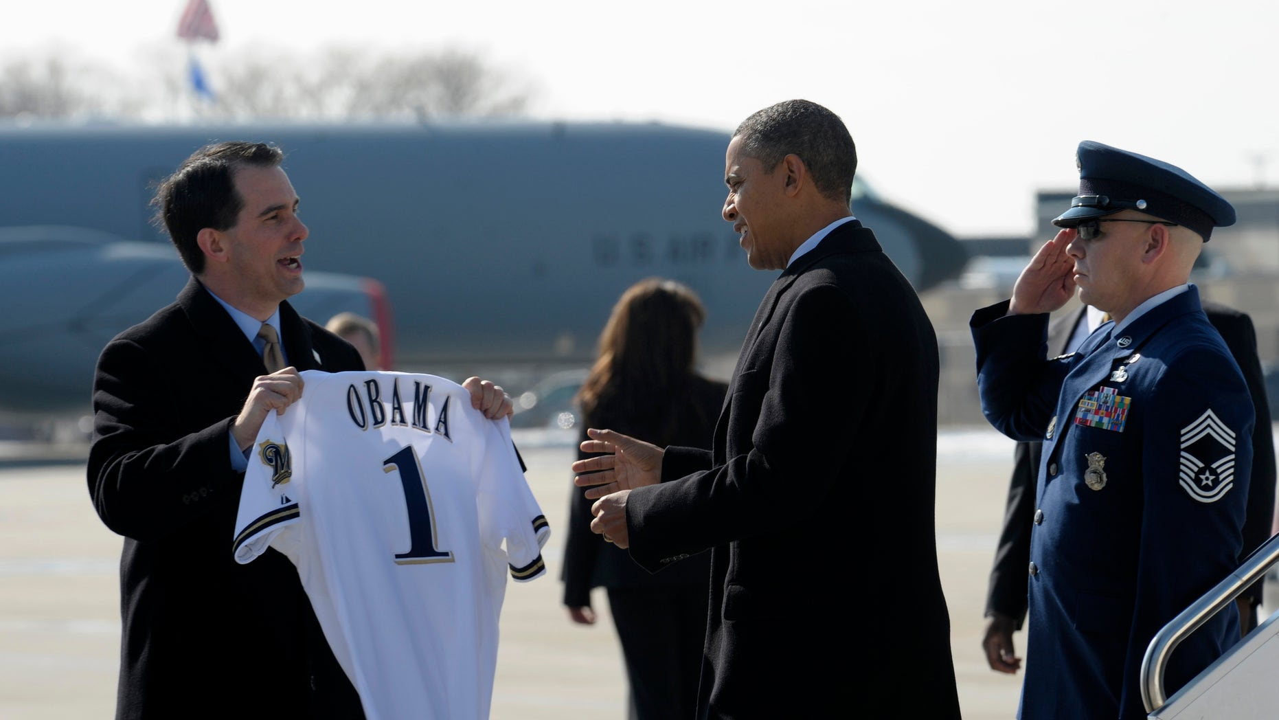 Feb. 15: Wisconsin Gov. Scott Walker presents President Barack Obama with a Milwaukee Brewers baseball jersey upon his arrival at General Mitchell International Airport in Milwaukee.