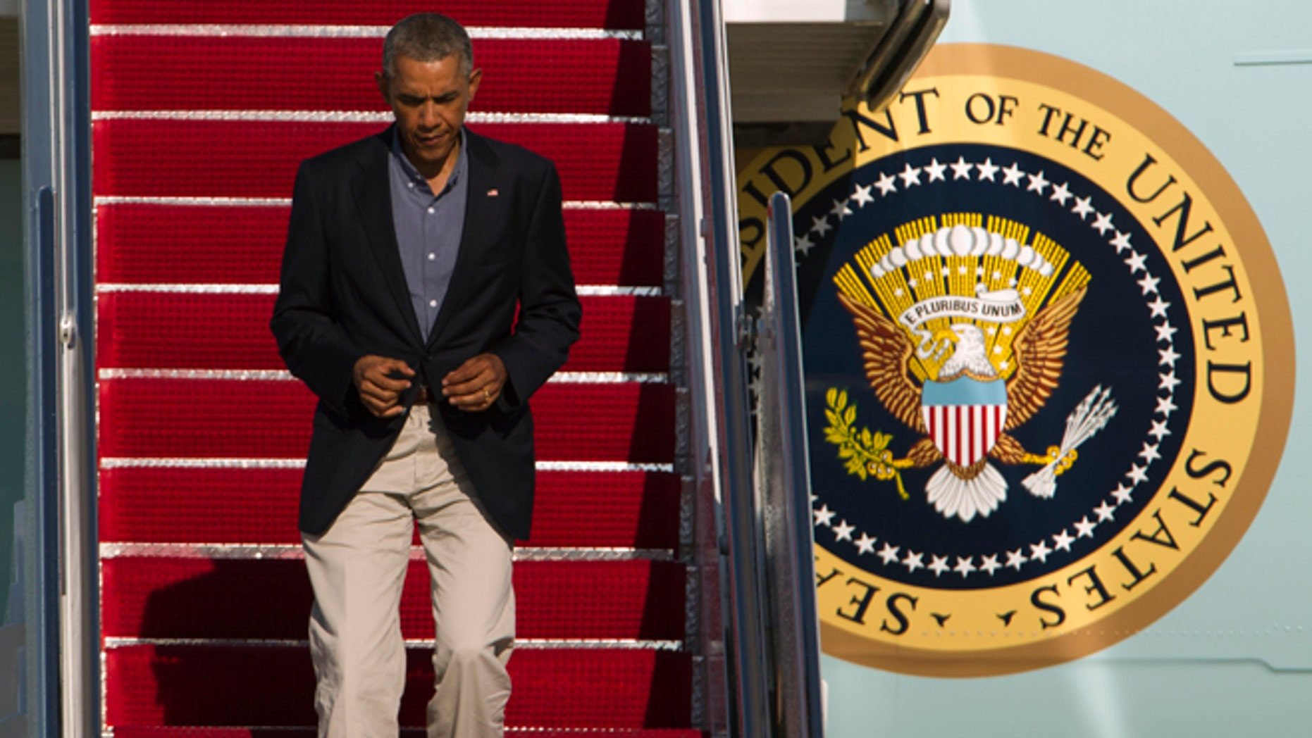 President Barack Obama walks down the stairs of Air Force One upon arrival at Andrews Air Force Base, Md., Monday, Sept. 1, 2014.