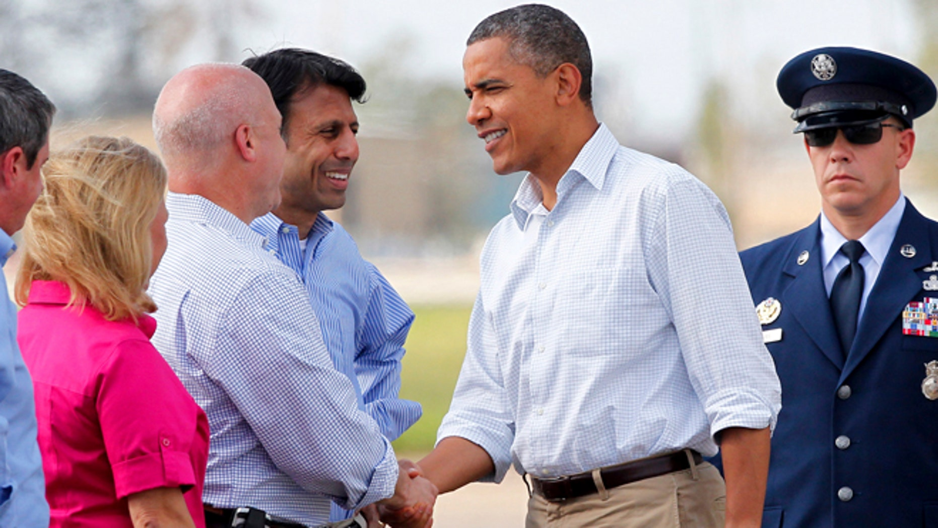 Sept. 3, 2012: President Barack Obama greets New Orleans Mayor Mitch Landrieu, as Louisiana Gov. Bobby Jindal, center, and Sen. Mary Landrieu, D-La., watch as he arrives at Louis Armstrong New Orleans International Airport in Kenner, La.