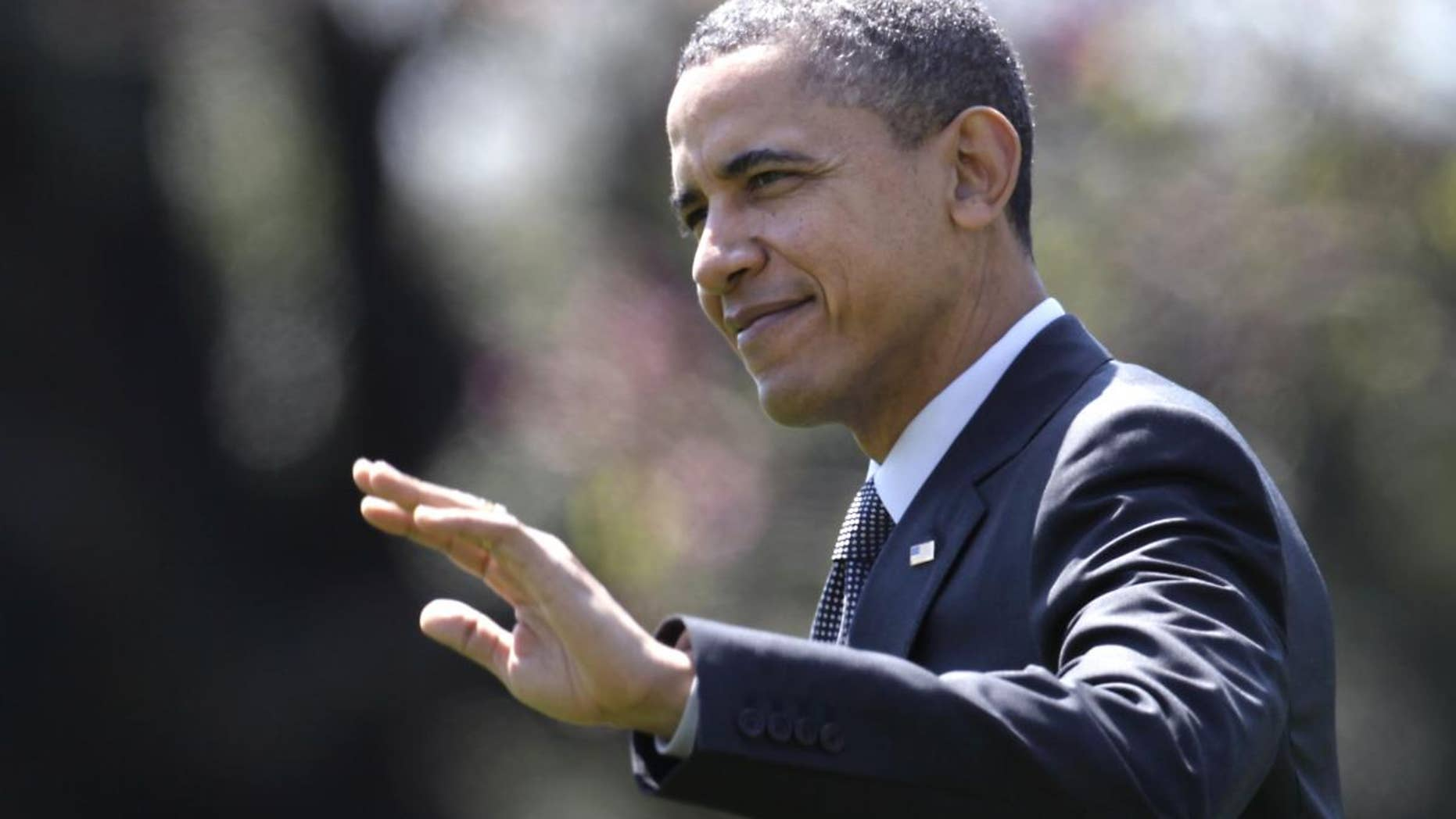 President Barack Obama waves as he walks across the South Lawn of the White House in Washington, Wednesday, April 6, 2011, to board Marine One as he travels to Pennsylvania. (AP Photo/Carolyn Kaster)