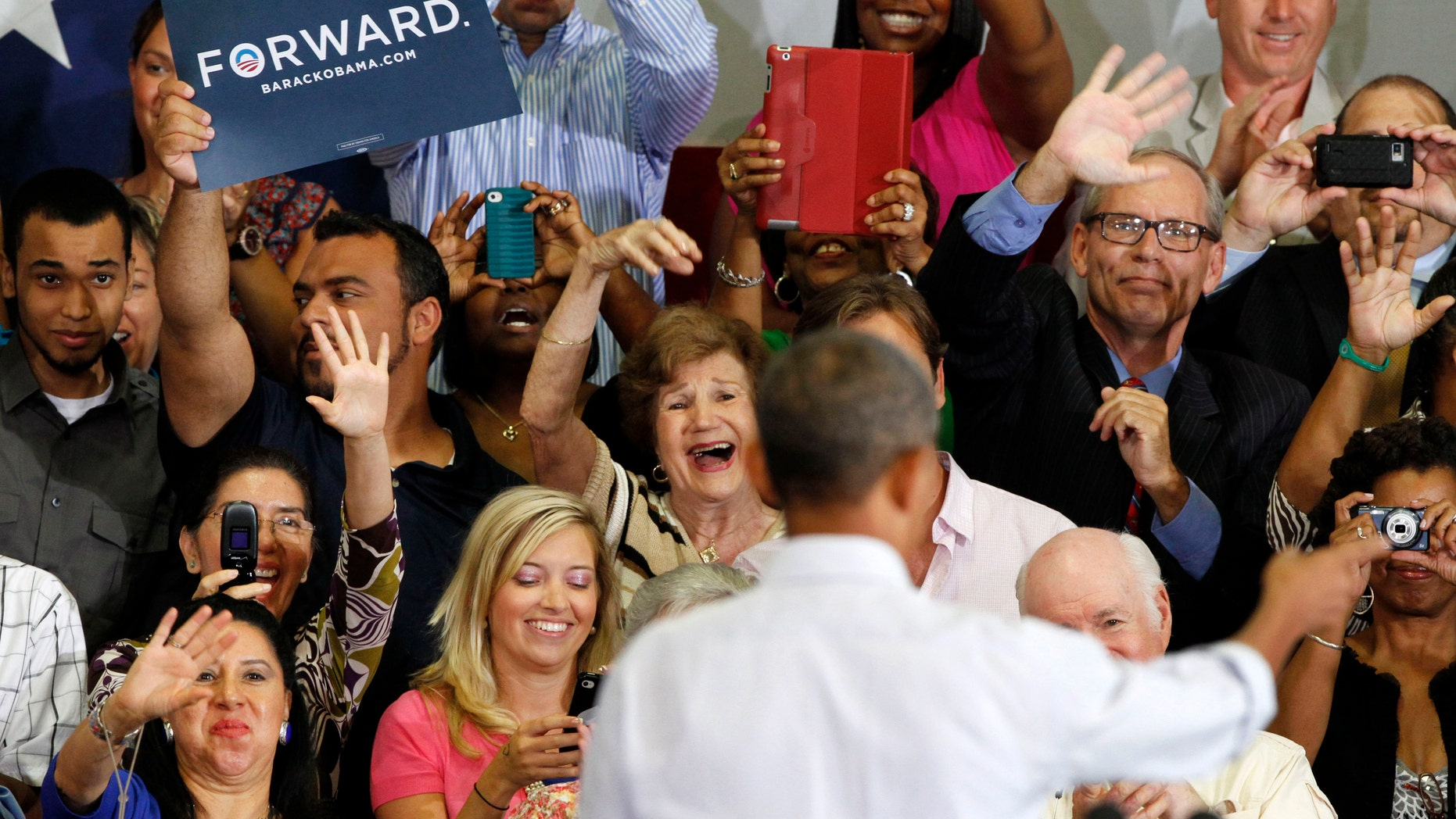 FILE: July 13, 2012: President Barack Obama waves to the supporters after a campaign speech at Green Run High School in Virginia Beach, Va.