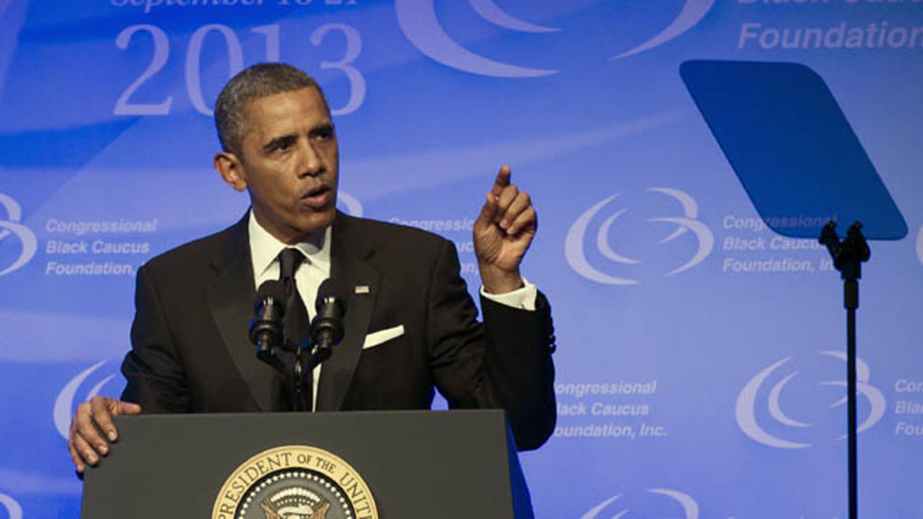 September 21, 2013: President Barack Obama addresses the 43rd annual Congressional Black Caucus Foundation's Legislative Conference dinner in Washington Saturday. (AP Photo)
