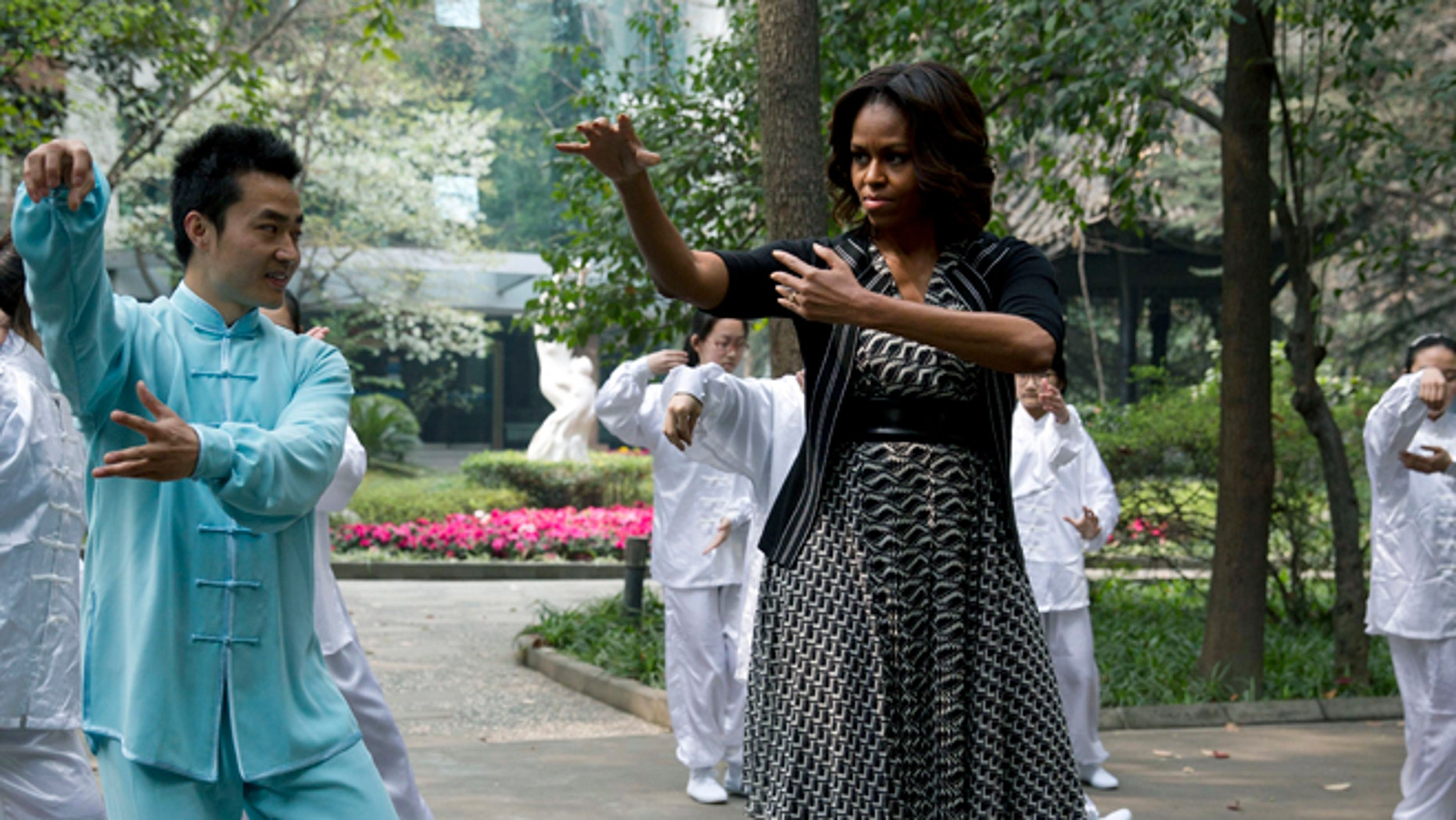 March 25, 2014: First lady Michelle Obama practices tai chi at a high school in Chengdu in southwest China's Sichuan province.