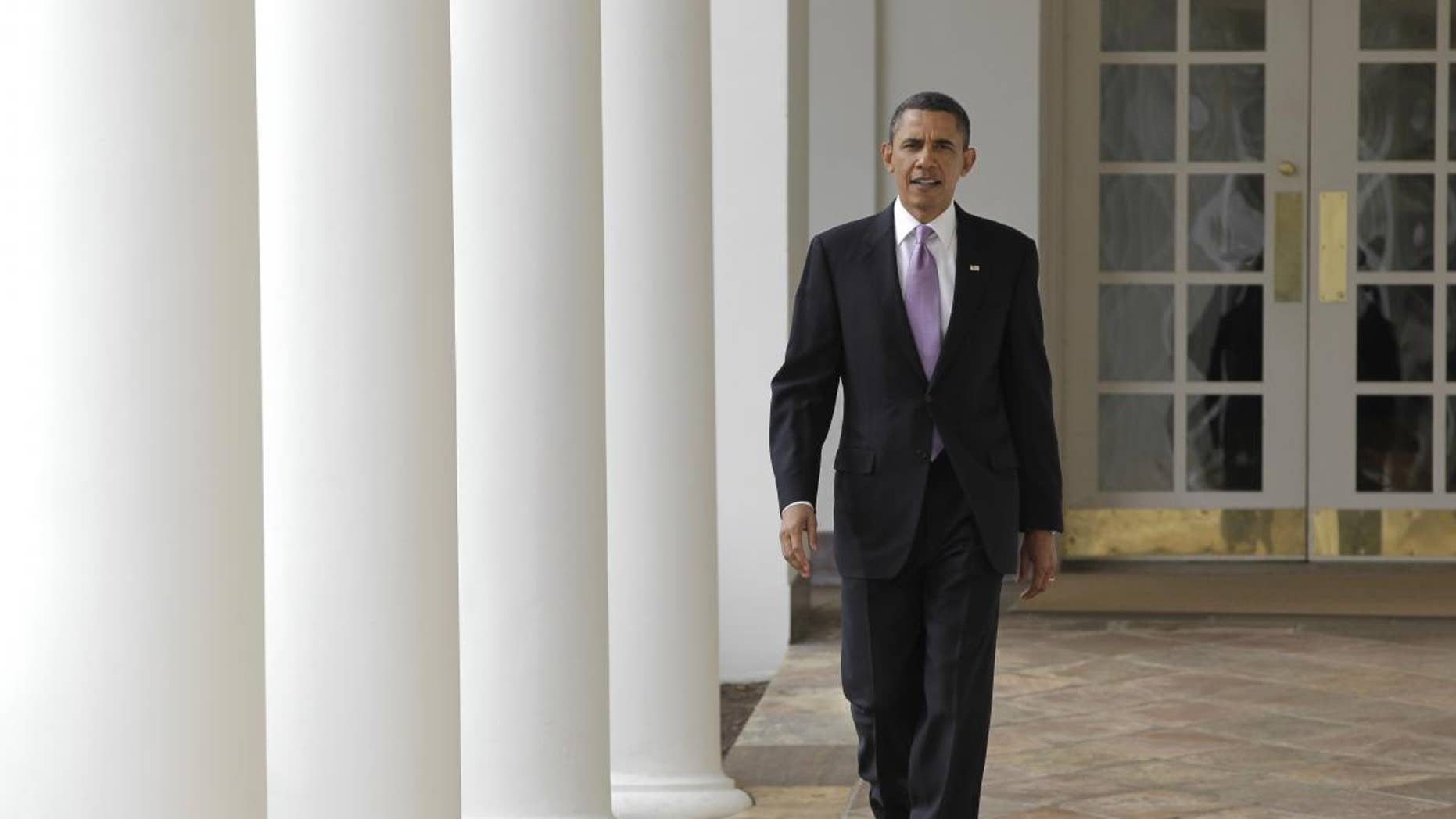 On the day of his State of the Union address, President Barack Obama strides from the Oval Office along the Colonnade at the White House in Washington, Tuesday, Jan. 25, 2011. (AP Photo/J. Scott Applewhite)