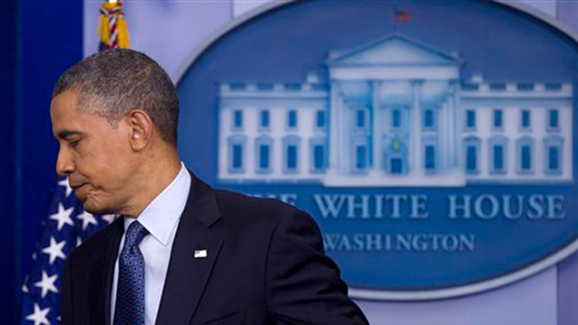 June 8, 2012: President Barack Obama leaves after speaking about the economy in the White House briefing room.
