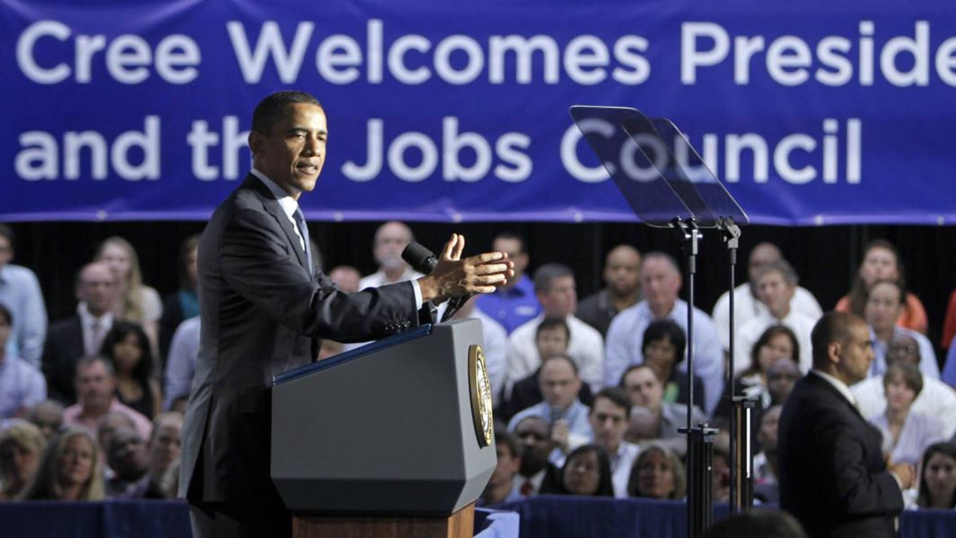President Barack Obama speaks to employees and guests at Cree, Inc., a leading manufacturer of energy-efficient LED lighting, in Durham, N.C., Monday, June 13, 2011. (AP Photo/Chuck Burton)