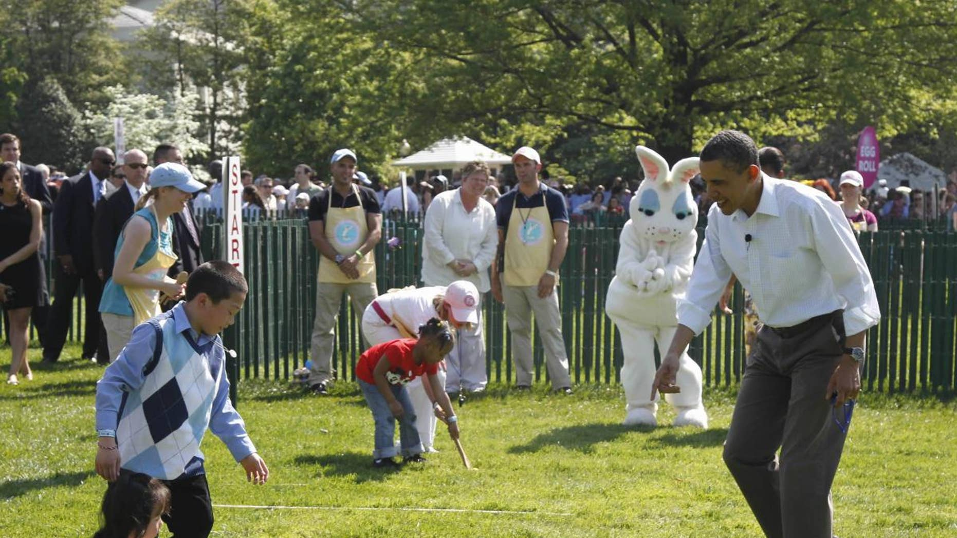 President Barack Obama cheers on children rolling Easter eggs at the White House Easter Egg Roll on the South Lawn of the White House in Washington, Monday, April 25, 2011. (AP Photo/Charles Dharapak)