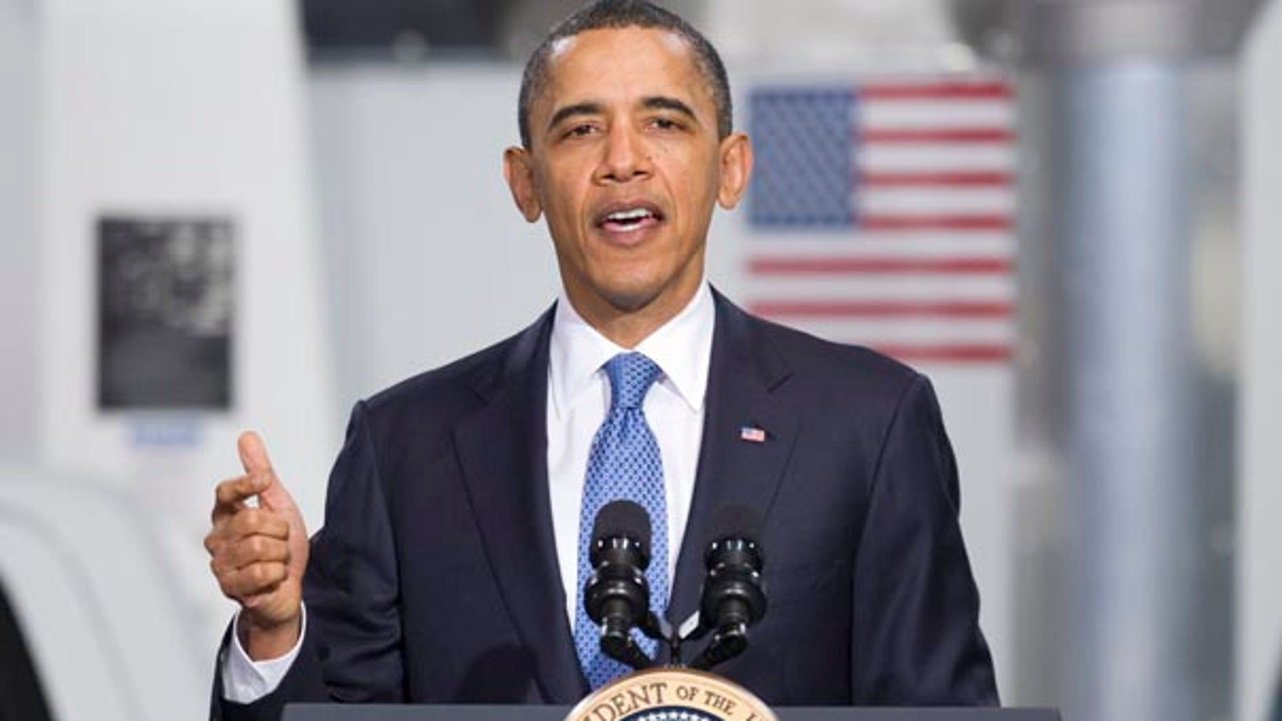 Friday: President Obama gestures while speaking at a UPS facility in Landover, Md.