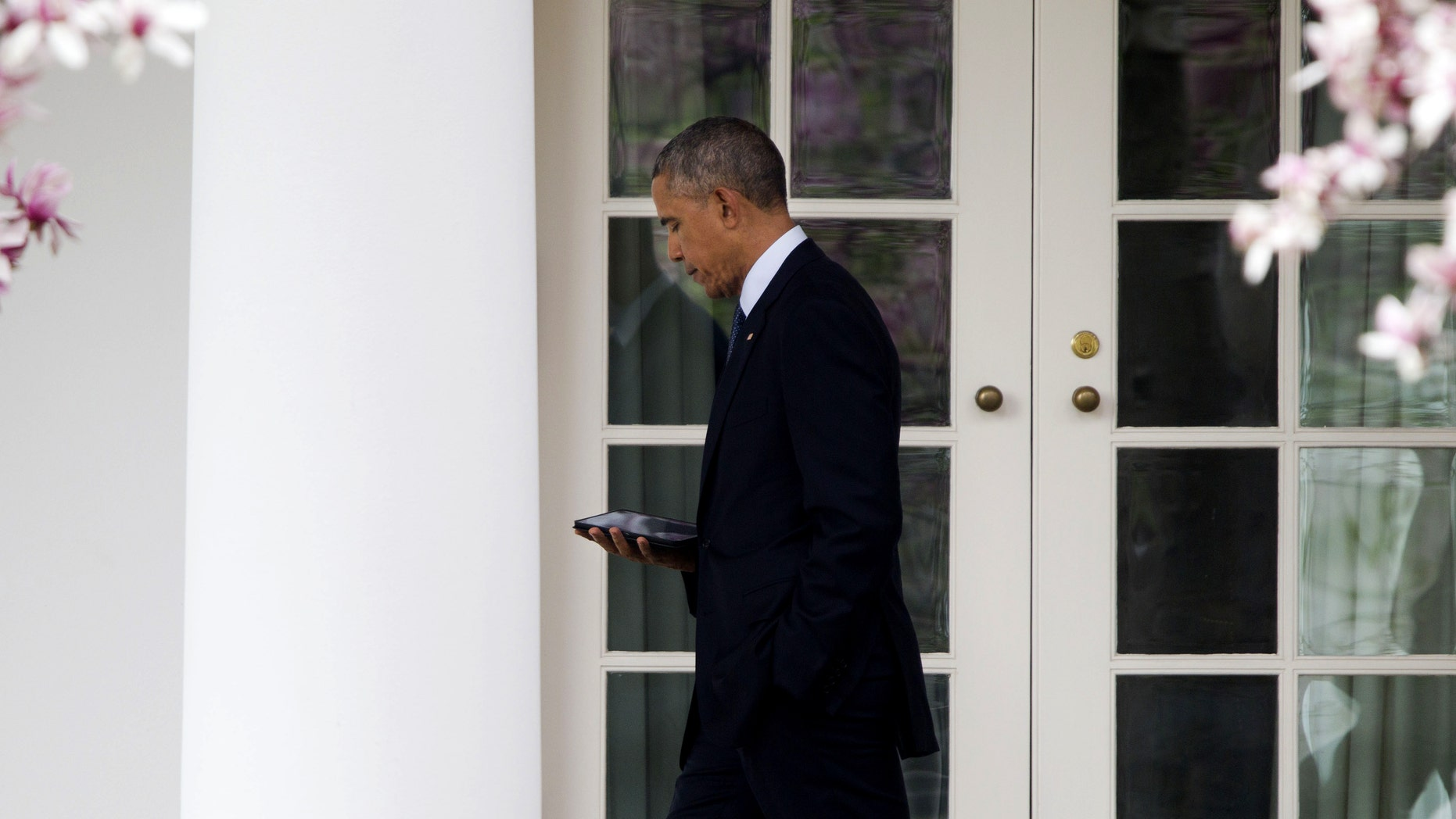 President Obama walks back to the Oval Office of the White House in Washington, Tuesday, April 7, 2015.