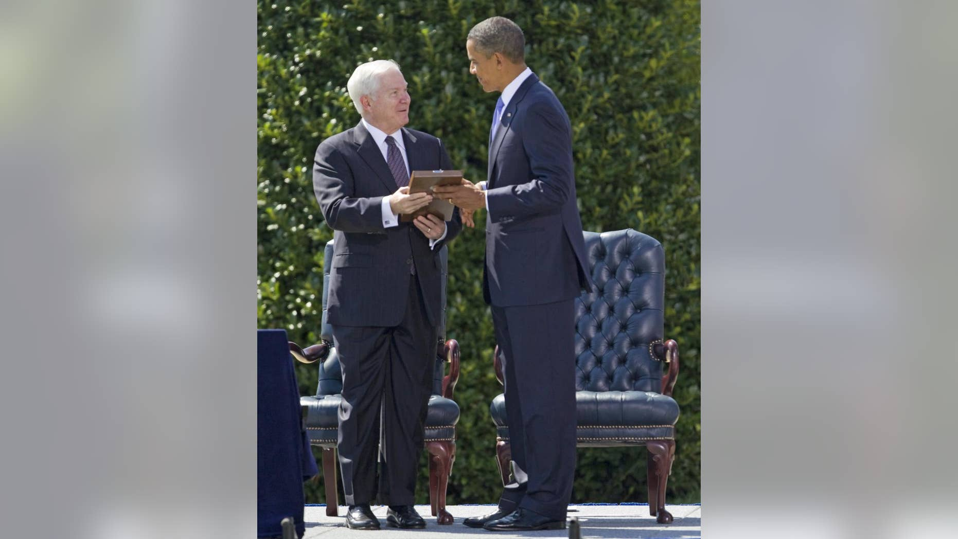 President Barack Obama presents outgoing Defense Secretary Robert Gates with the Presidential Medal of Freedom during a farewell ceremony for Gates, Thursday, June 30, 2011, at the Pentagon. (AP Photo/Evan Vucci)