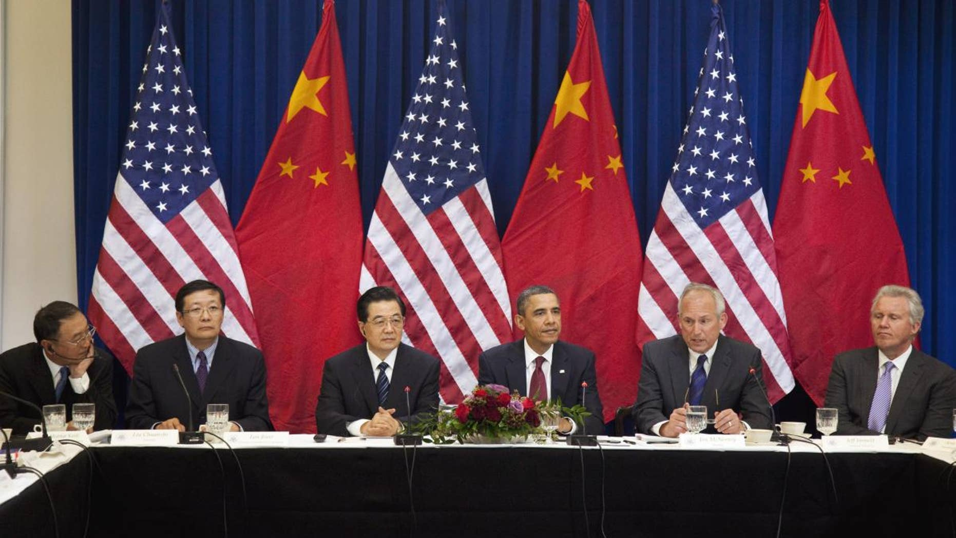 President Barack Obama and China's President Hu Jintao, meet with business leaders, Wednesday, Jan. 19, 2011, in the Eisenhower Executive Office Building on the White House complex in Washington. From left are, Liu Chuanzhi of Lenovo; Lou Jiwei of China Investment Corporation; President Hu; President Obama; Jim McNerney of CEO Boeing; and Jeff Immelt of CEO General Electric. (AP Photo/Evan Vucci)