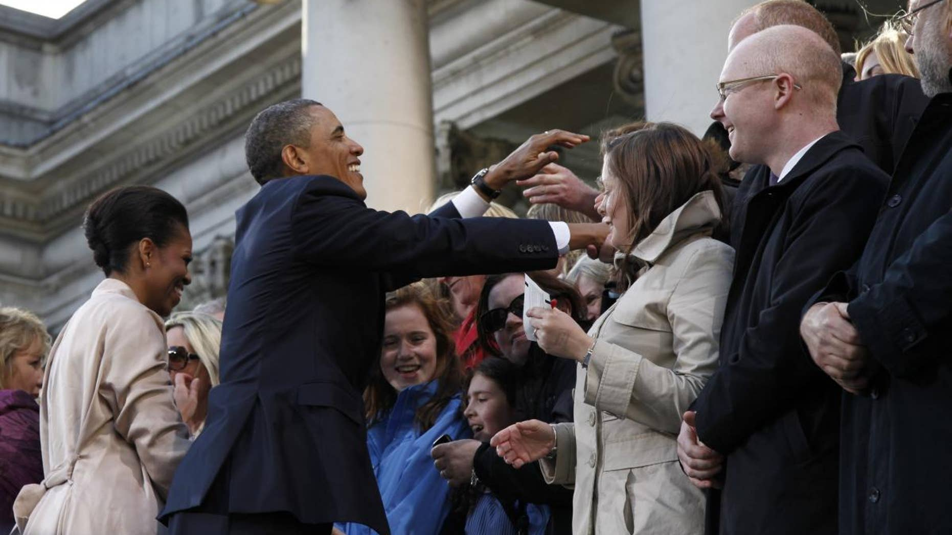 U.S. President Barack Obama and first lady Michelle Obama greet the crowd at College Green in Dublin, Ireland, Monday, May 23, 2011. (AP Photo/Charles Dharapak)